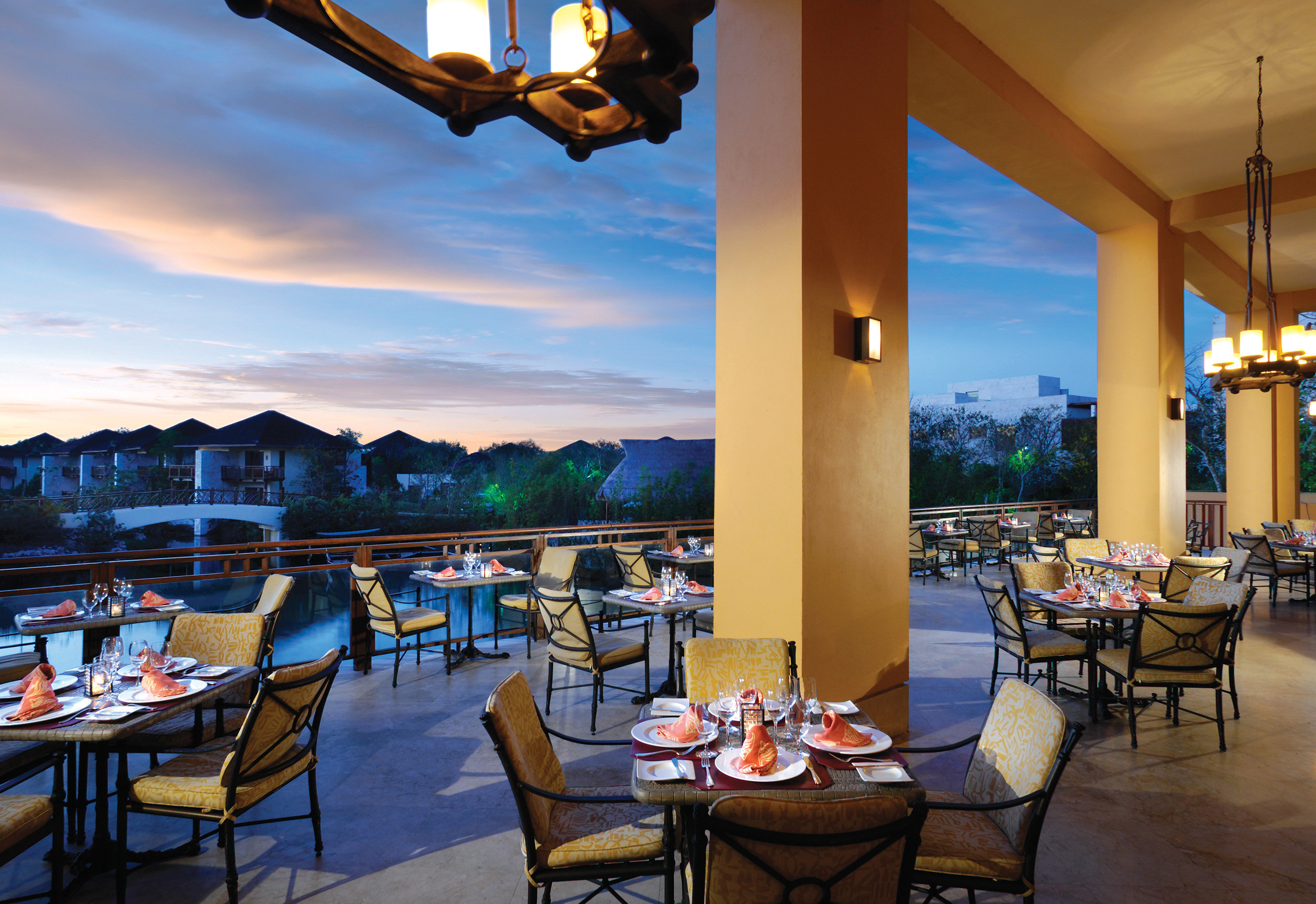 All-Inclusive Resorts Beachfront caribbean Dining Drink Eat Family Family Travel Hotels Resort sky table chair floor indoor restaurant estate vacation Villa set furniture