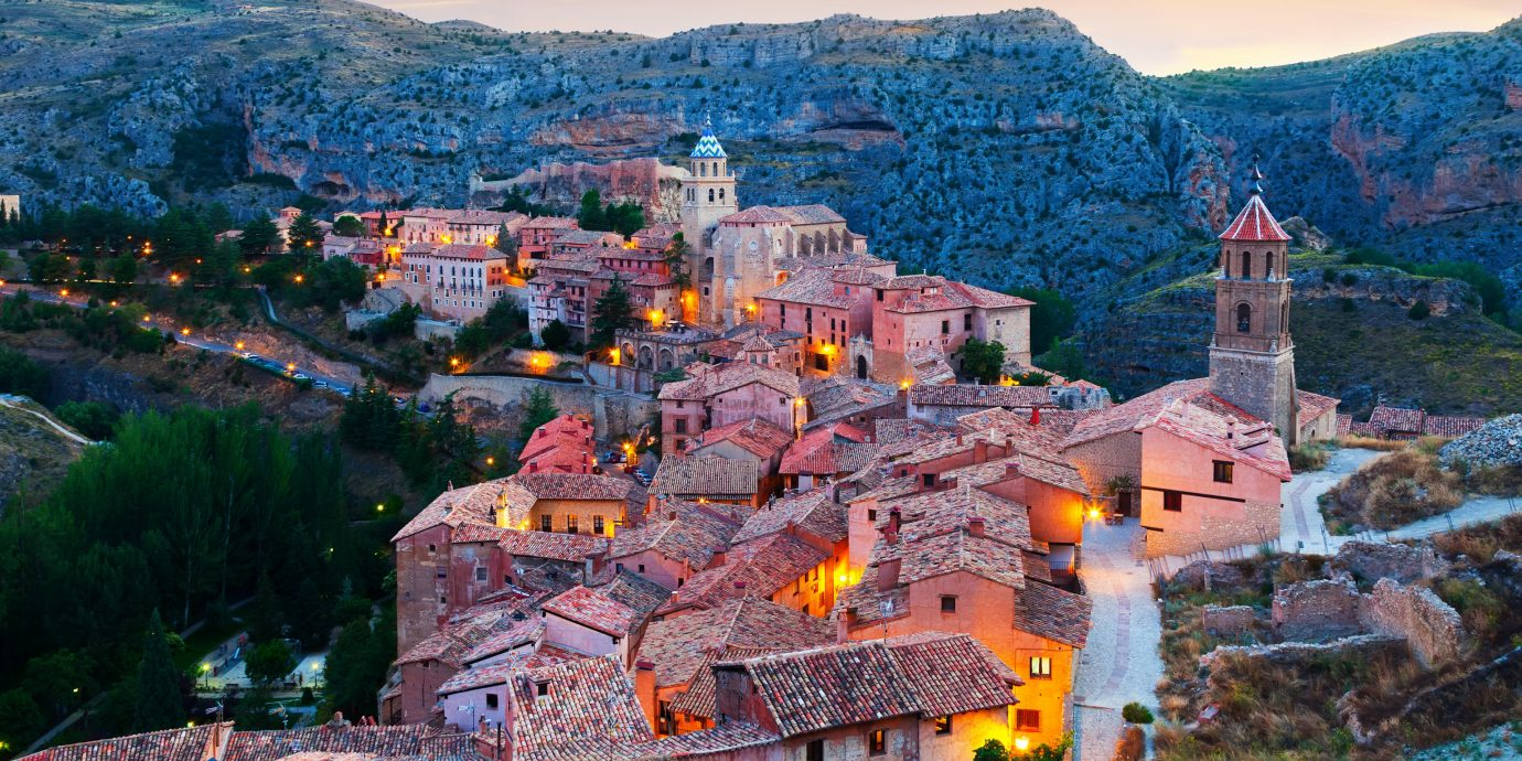 europe Spain Trip Ideas mountain sky canyon mountain village valley grass outdoor landmark Village Town City evening morning historic site rural area mountain range tree tourism tourist attraction landscape dawn hill mount scenery autumn house colorful hillside