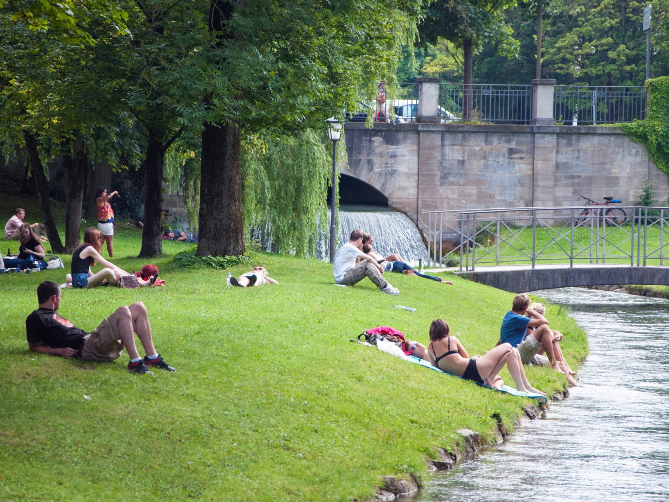 Berlin Germany Munich Trip Ideas tree grass outdoor leisure park group people waterway