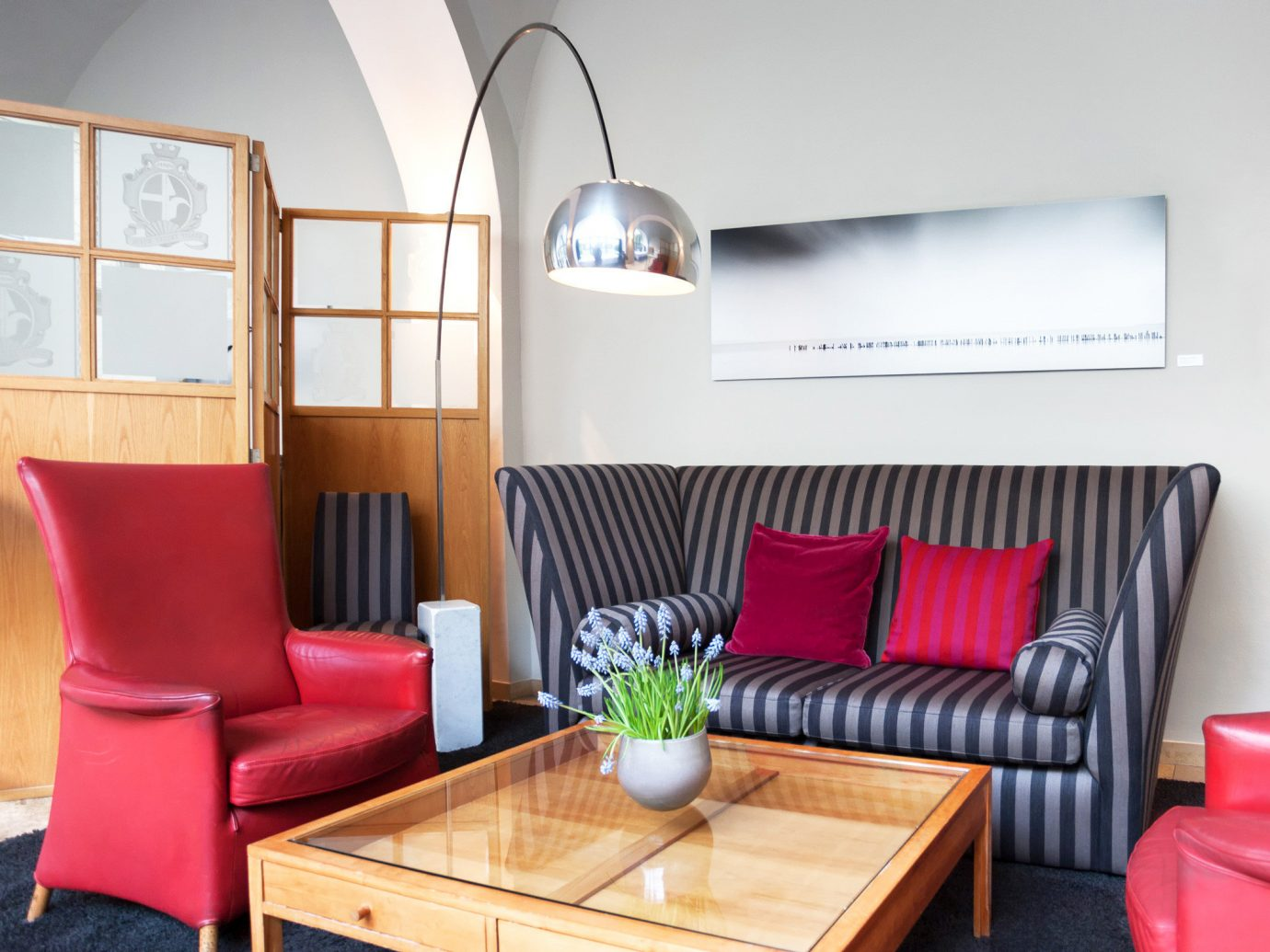 Austria City Design europe Hip Hotels Lounge Modern Vienna floor indoor wall Living room living room property interior design red furniture cottage Suite real estate dining room apartment leather