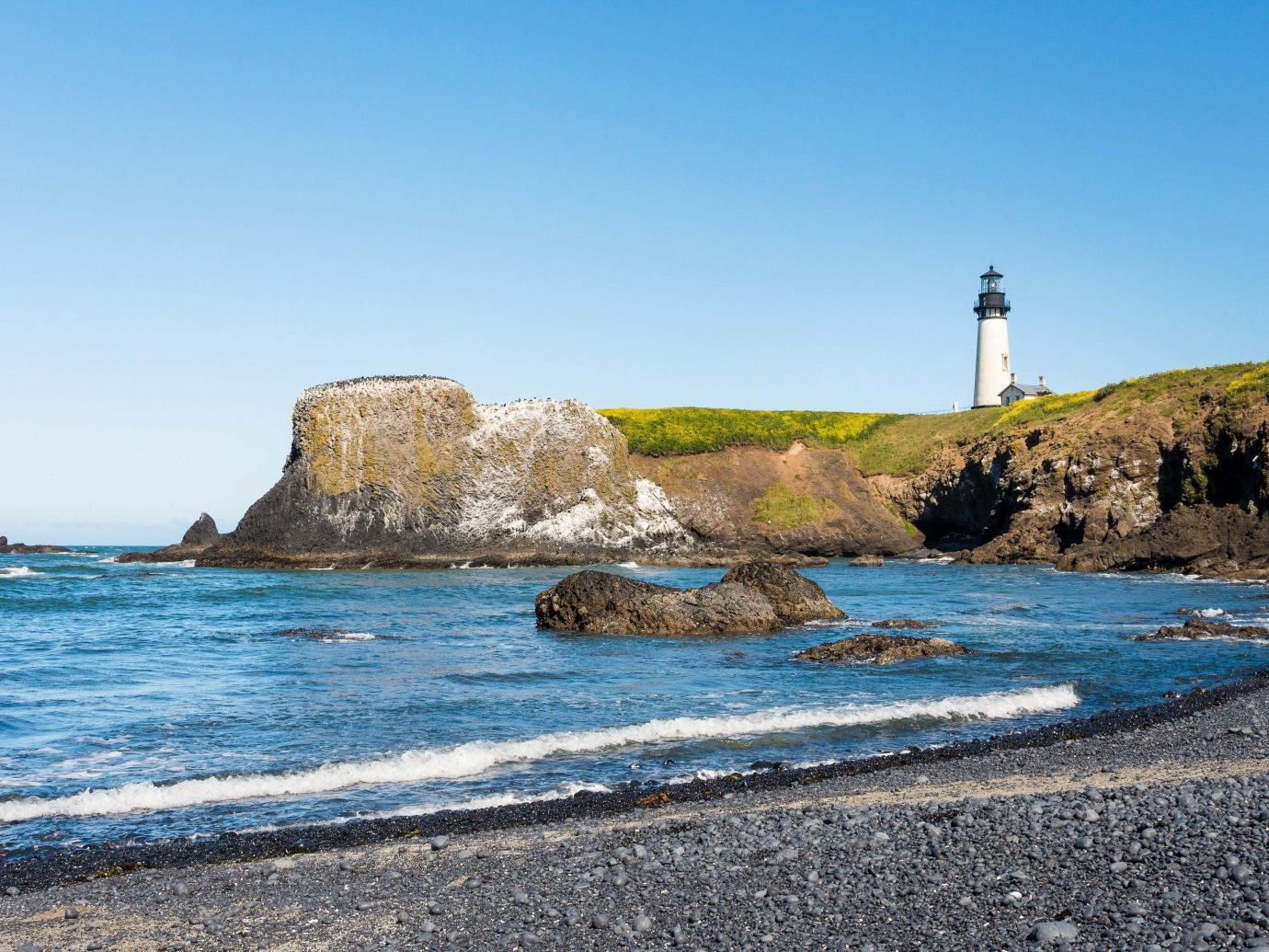 America Beach Trip Ideas West Coast Coast Sea headland lighthouse shore promontory coastal and oceanic landforms sky tower cape Ocean bay cove