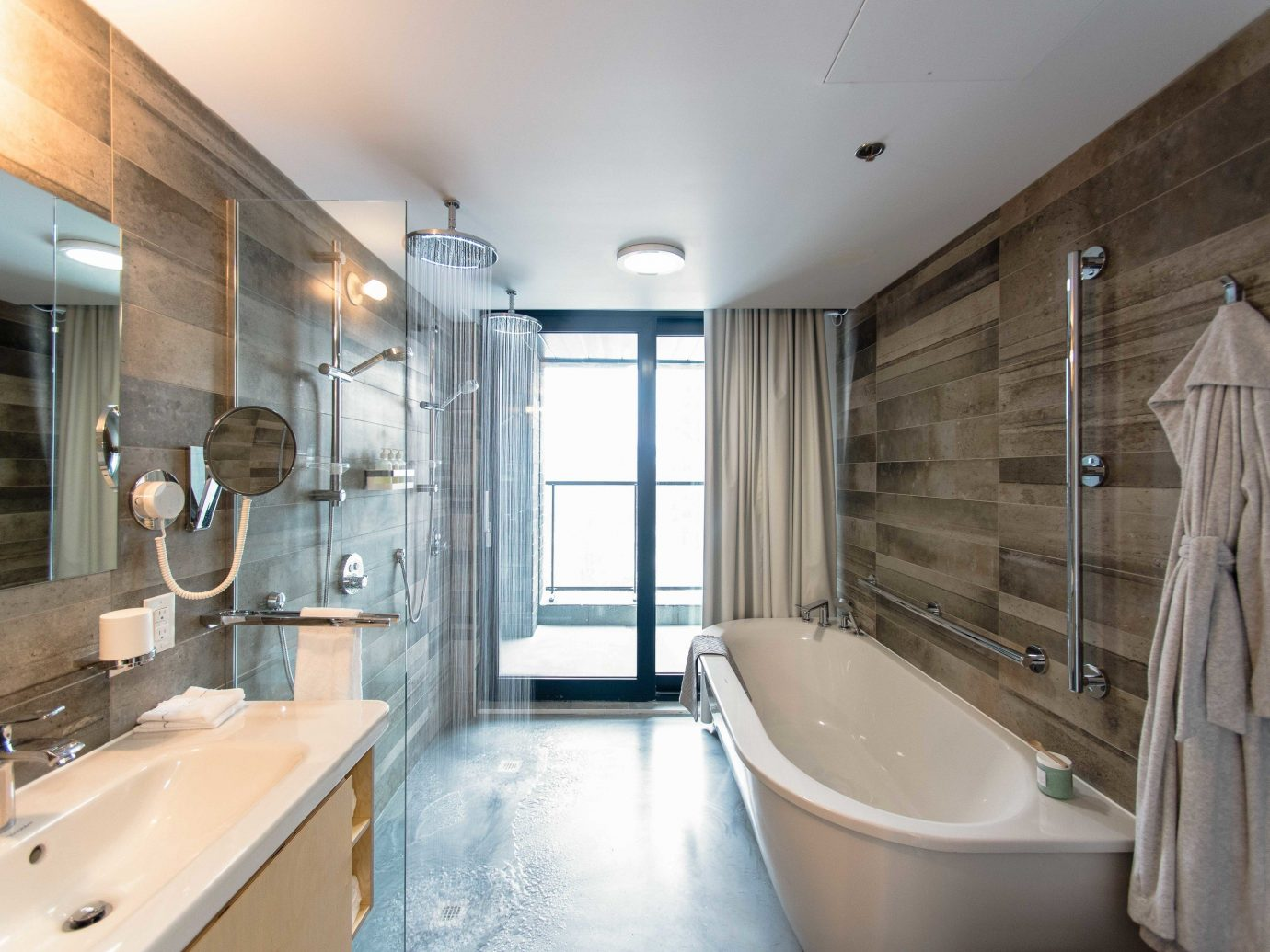 Boutique Hotels Chicago Hotels indoor wall bathroom floor ceiling room property window interior design estate home sink tub real estate flooring interior designer bathtub toilet Bath Modern tile tiled
