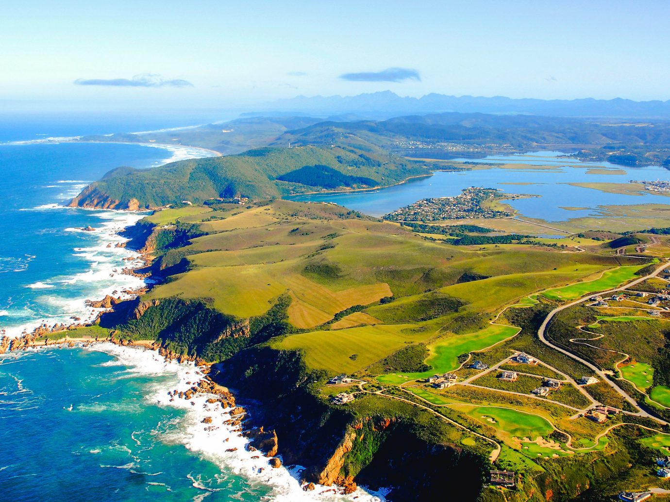 Thiesen Island, Knysna aerial photography Coast bird's eye view headland Sea promontory photography sky cape coastal and oceanic landforms water bay mount scenery tourism horizon peninsula grass inlet Ocean