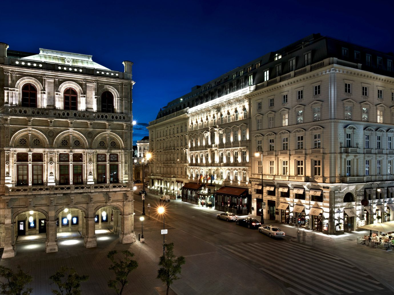 Architecture Austria Buildings Design europe Exterior Hotels Nightlife Vienna building sky metropolitan area outdoor landmark plaza City metropolis Town night urban area human settlement cityscape town square neighbourhood Downtown street facade evening palace government building