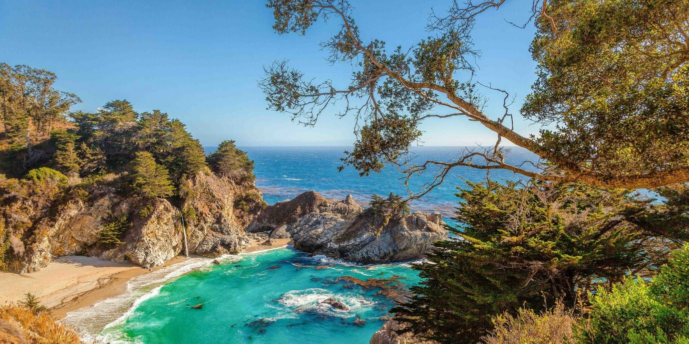 America Beach Hotels Trip Ideas West Coast Nature Coast nature reserve water vegetation promontory Sea rock bay tree cove coastal and oceanic landforms terrain sky cliff inlet Lagoon Ocean cape tourism landscape mount scenery national park
