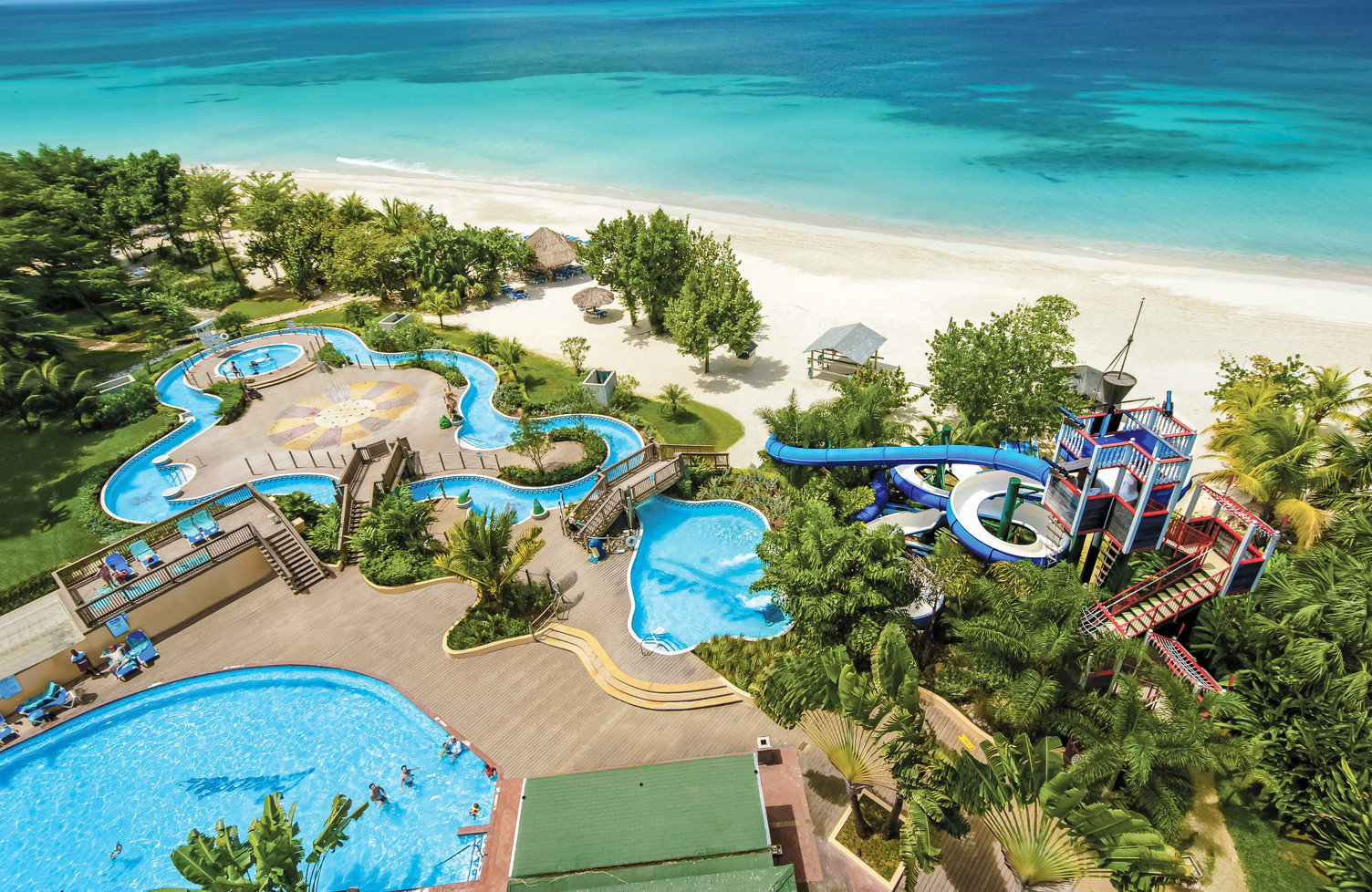 All-Inclusive Resorts Family Travel Hotels leisure Resort tourism amusement park aerial photography bird's eye view vacation resort town swimming pool recreation water tropics coastal and oceanic landforms tree Water park caribbean bay