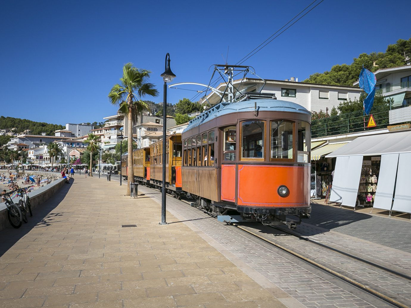 europe Spain Trip Ideas transport tram sky train rail transport cable car tree track rolling stock public transport plant railroad car metropolitan area electricity electrical supply vehicle City train station