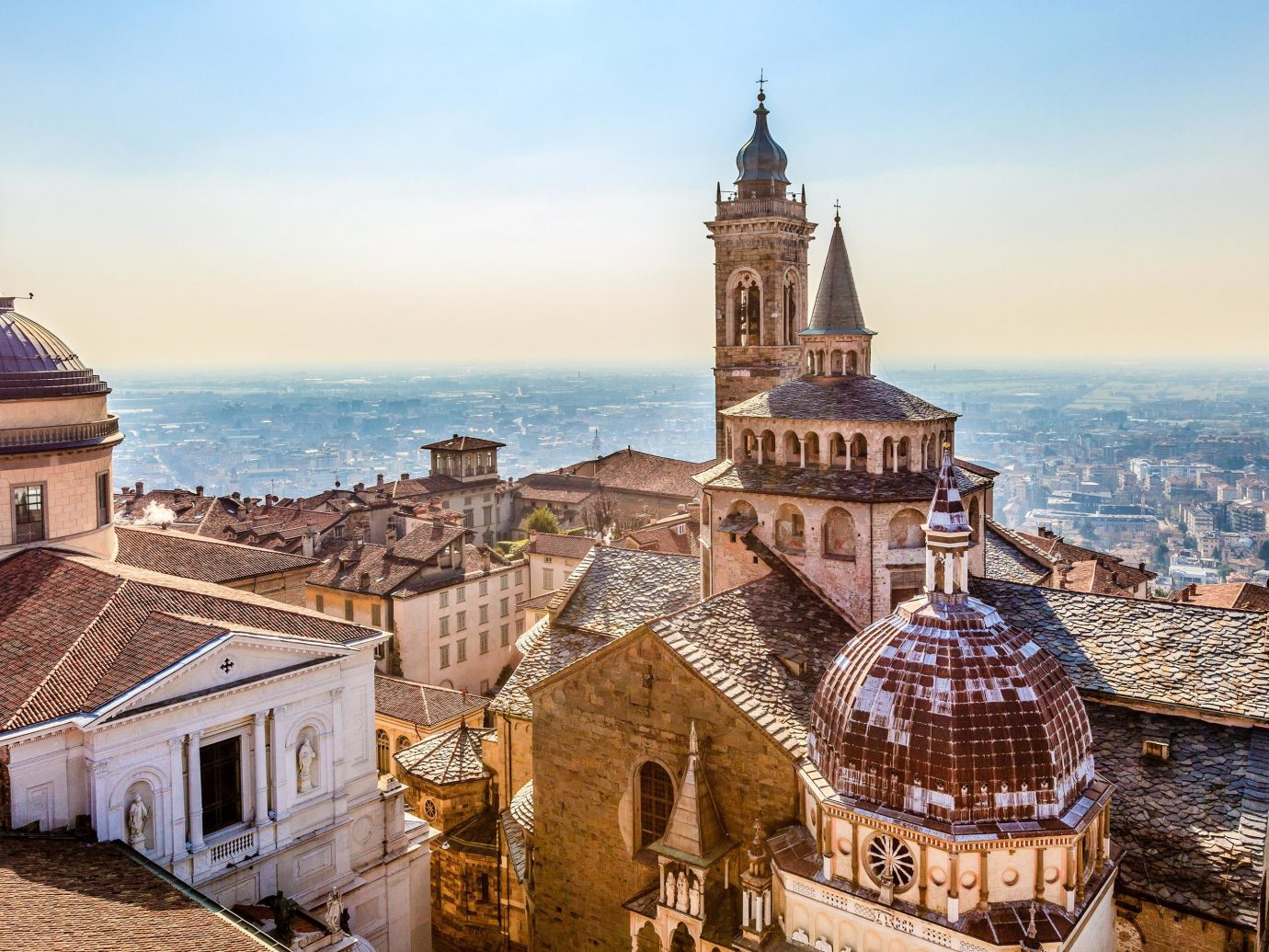 europe Italy Off-the-beaten Path Trip Ideas sky landmark Town City historic site building history spire ancient history medieval architecture tourism tourist attraction steeple roof château Church bell tower tower middle ages place of worship cathedral facade basilica monastery