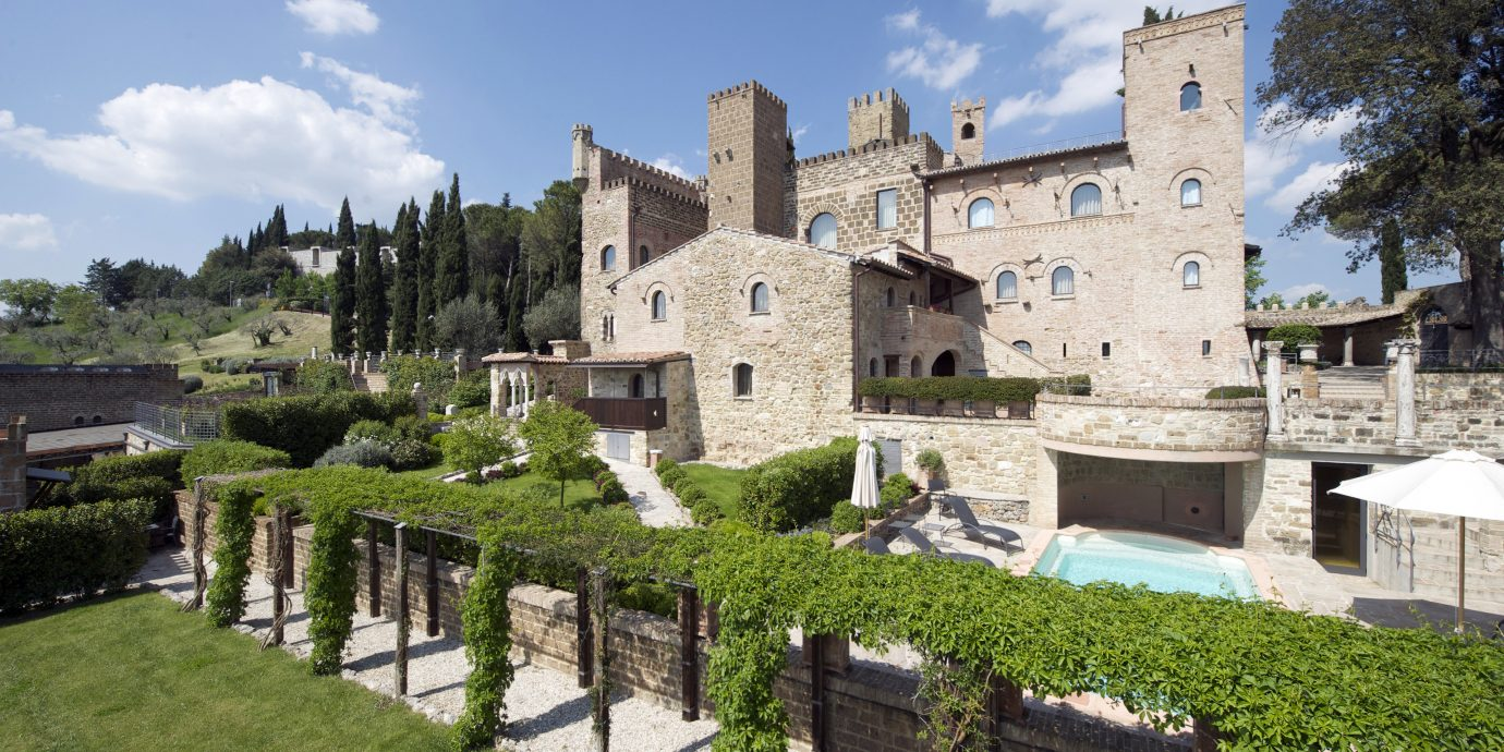 europe Hotels Italy Romance property Village château estate castle building medieval architecture historic site tree Villa sky