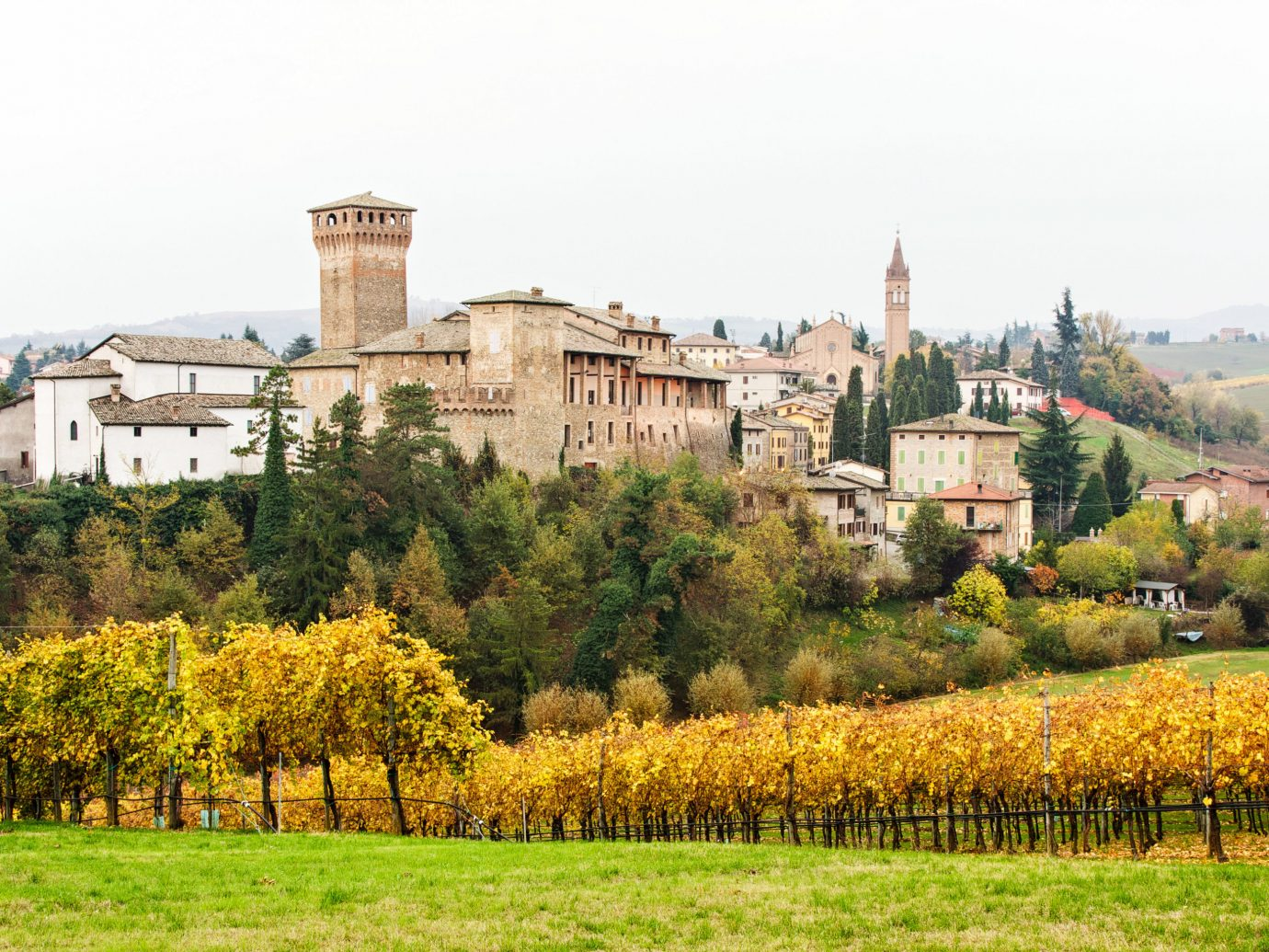 europe Italy Off-the-beaten Path Trip Ideas Village sky Town field agriculture Vineyard rural area tree château stately home estate meadow national trust for places of historic interest or natural beauty landscape hill grass house grassland castle autumn middle ages