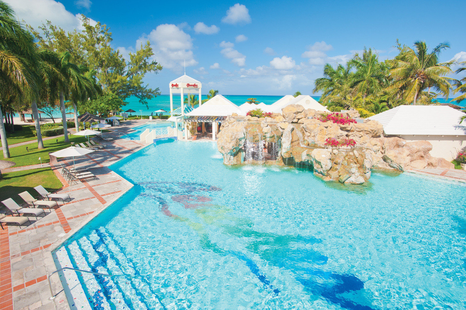 All-Inclusive Resorts Family Travel Hotels Resort leisure swimming pool caribbean vacation resort town tourism tropics water Lagoon palm tree coastal and oceanic landforms Water park bay Sea arecales sky recreation cay