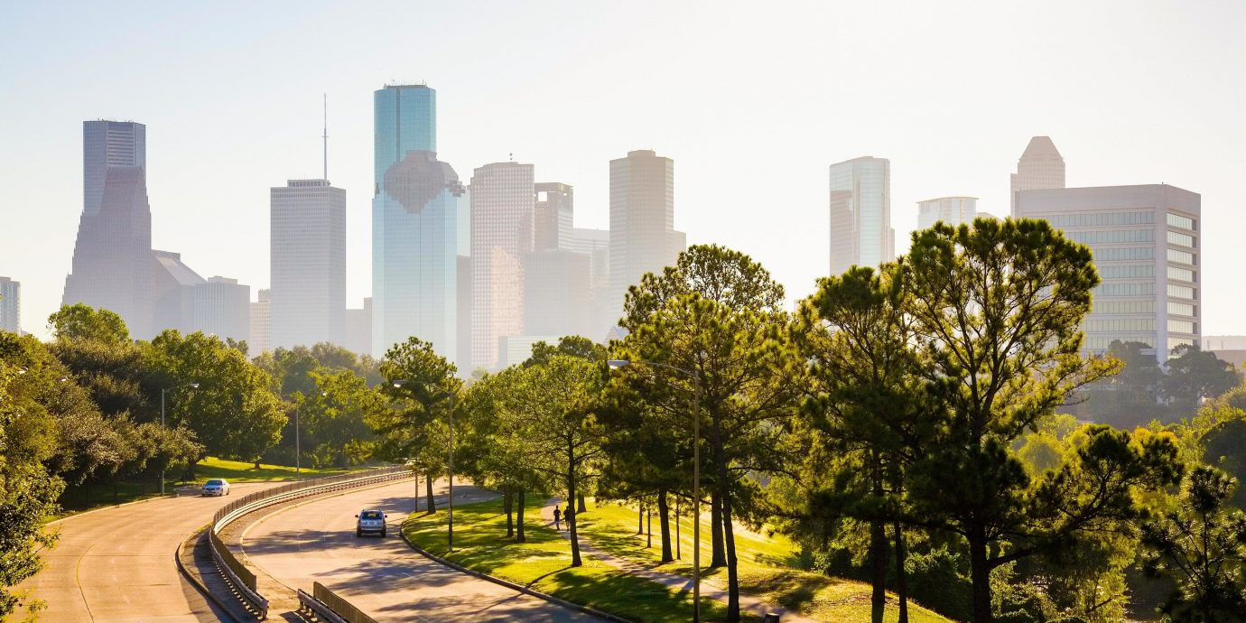 Houston Outdoors + Adventure Texas Trip Ideas metropolitan area City urban area skyline metropolis cityscape skyscraper daytime residential area tower block Architecture tree sky neighbourhood morning Downtown urban design condominium real estate suburb mixed use building sunlight grass landscape