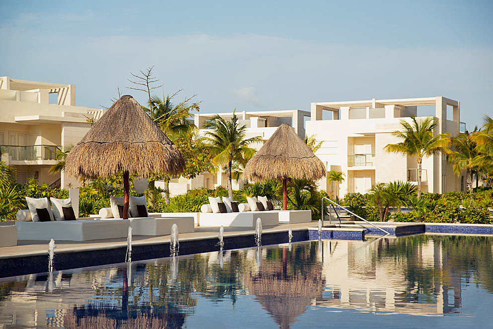 Adult-only All-Inclusive Resorts Cancun Hotels Mexico water outdoor building sky house property Resort estate home condominium swimming pool vacation residential area marina real estate dock Villa facade palace Harbor waterway apartment mansion several