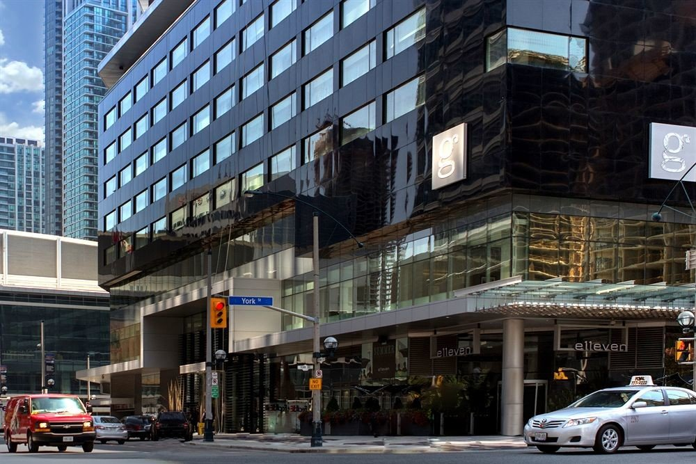 Canada Hotels Toronto building outdoor metropolitan area road street City Downtown urban area plaza human settlement Architecture metropolis shopping mall facade public transport infrastructure skyscraper cityscape apartment building tall