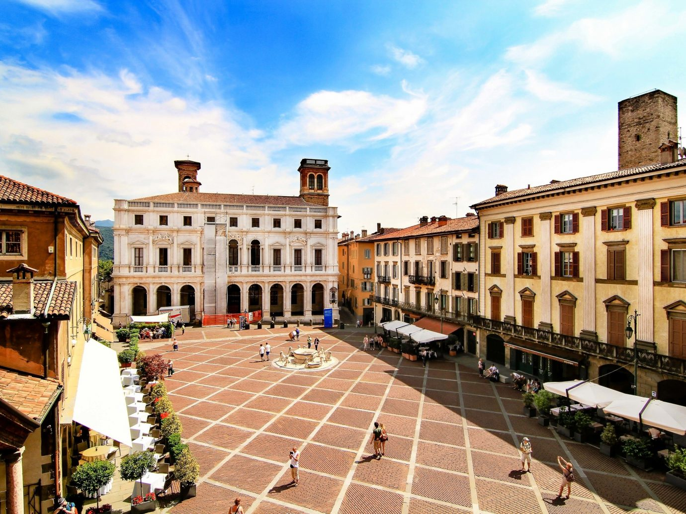 europe Italy Off-the-beaten Path Trip Ideas landmark Town property City sky plaza town square building neighbourhood historic site estate residential area real estate apartment facade tourism house ancient rome mansion window stately home roof