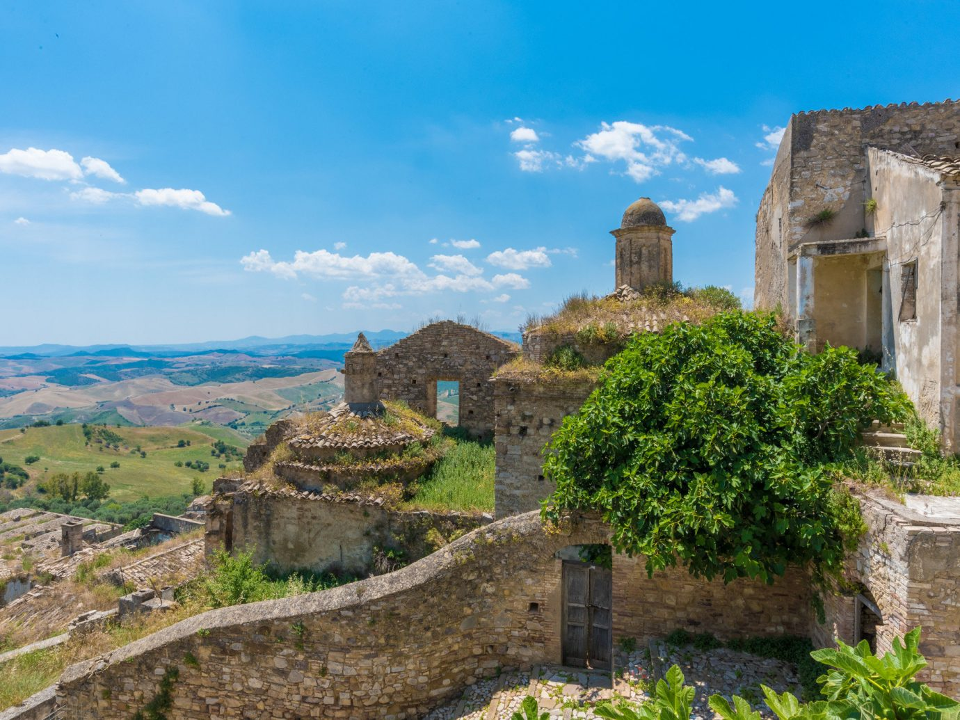 europe Italy Off-the-beaten Path Trip Ideas outdoor sky grass fortification historic site ancient history archaeological site Ruins wall stone Village history cloud tree mountain rock castle landscape middle ages tourism hillside