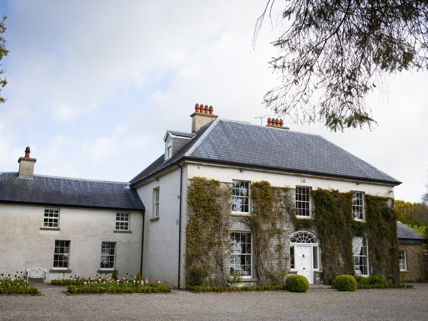 europe Hotels Ireland property house estate home cottage building farmhouse manor house mansion real estate roof facade window château tree sky Villa