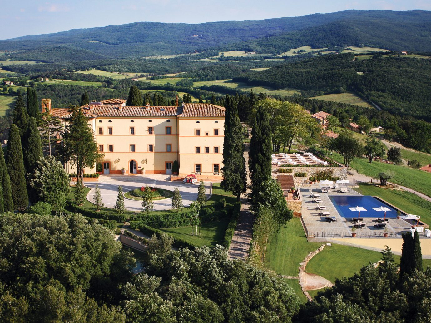 europe Hotels Italy Romance mountain tree outdoor grass sky aerial photography bird's eye view photography Town human settlement estate neighbourhood château Nature residential area hill hillside castle lush beautiful traveling