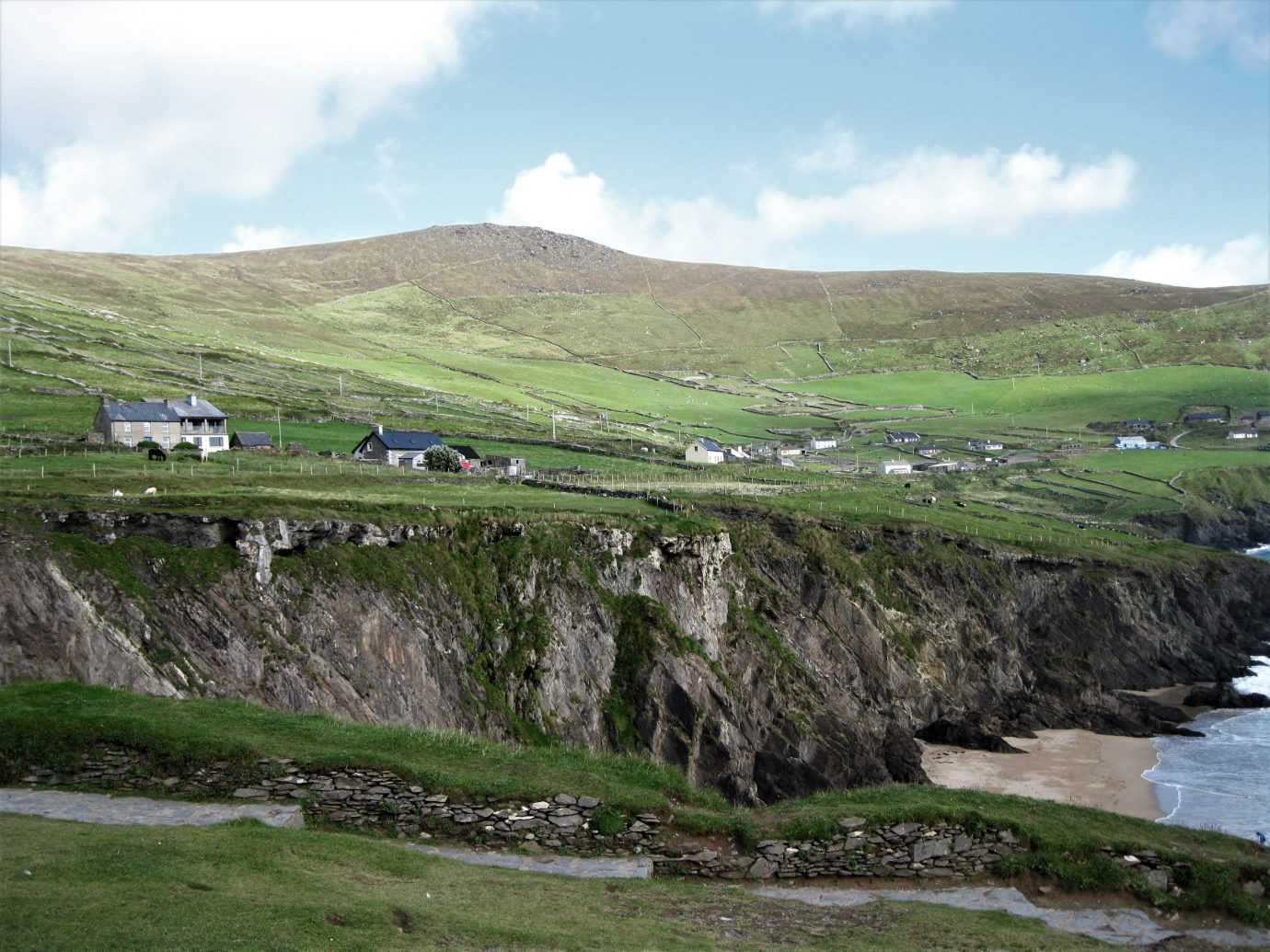 europe Hotels Ireland highland hill fell sky mountain Coast grass loch grassland terrain rural area water pasture landscape plateau cliff cloud escarpment ecoregion geology tundra rock reservoir fjord Lake plain