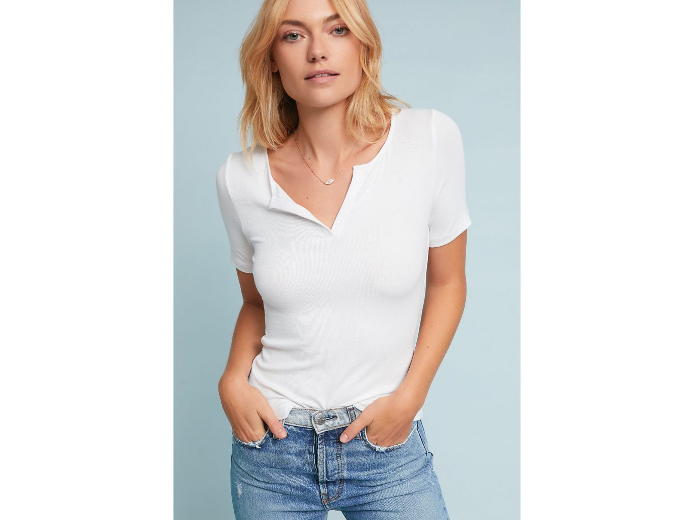 Spring Travel Style + Design Summer Travel Travel Lifestyle Travel Shop person clothing white woman sleeve neck posing t shirt shoulder arm fashion model model muscle supermodel top undershirt joint