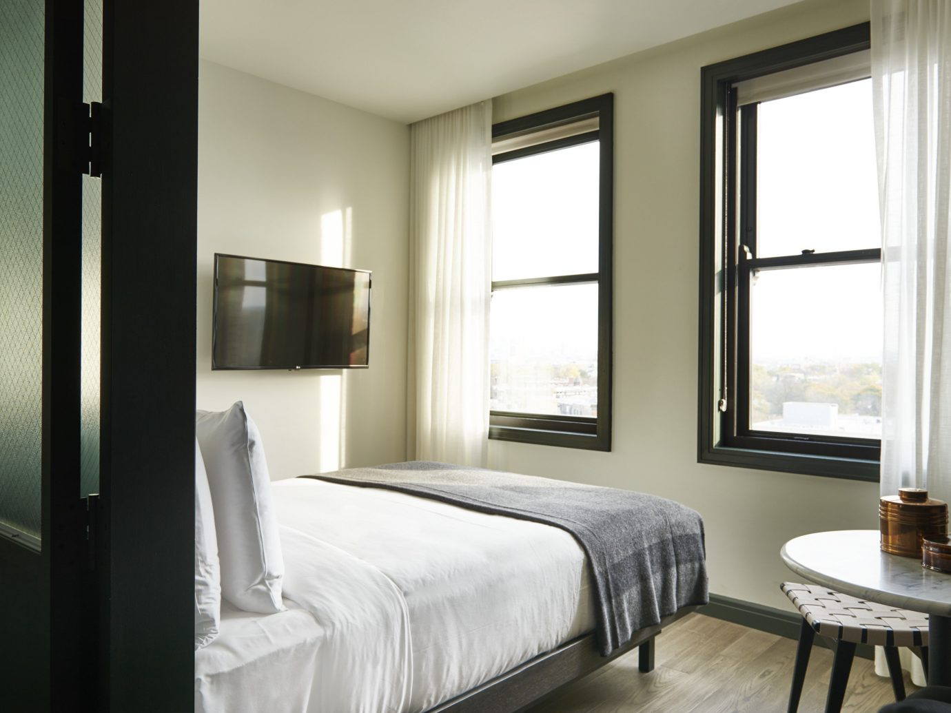 Boutique Hotels Chicago Hotels indoor bed wall hotel window floor room Bedroom property ceiling Suite interior design home real estate condominium estate cottage apartment living room lamp