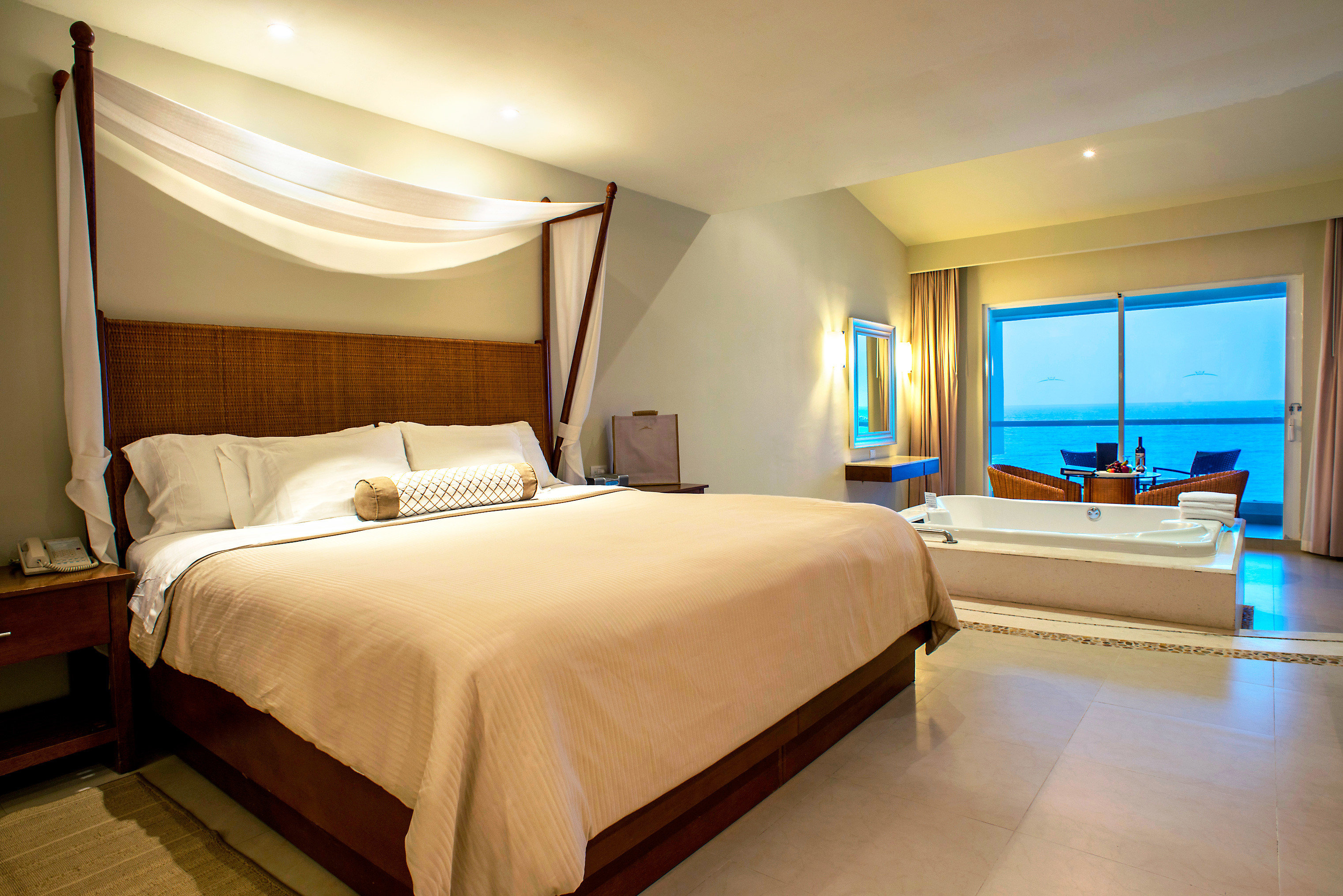 Adult-only All-Inclusive Resorts Beachfront Bedroom Cancun Hotels Luxury Mexico Modern Patio Scenic views Suite bed floor indoor wall hotel ceiling room property estate real estate cottage interior design Villa apartment tan
