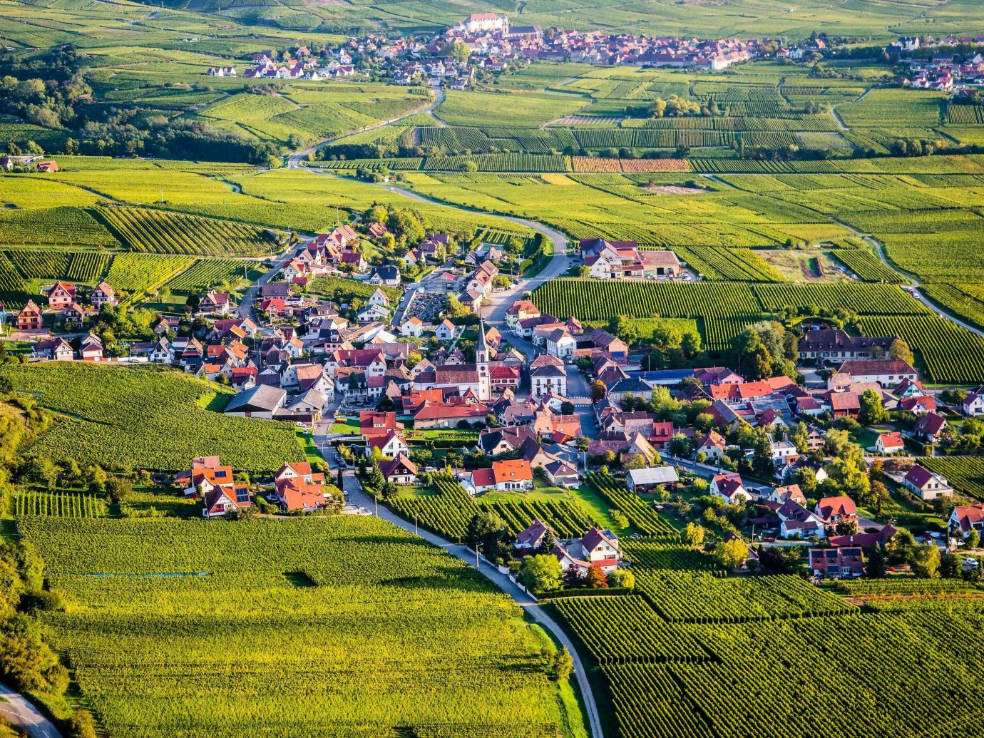 europe Outdoors + Adventure Trip Ideas aerial photography bird's eye view field grassland highland Village suburb rural area mountain village photography residential area agriculture hill meadow sky grass Farm landscape tree hill station land lot City mount scenery pasture plain plant mountain panorama