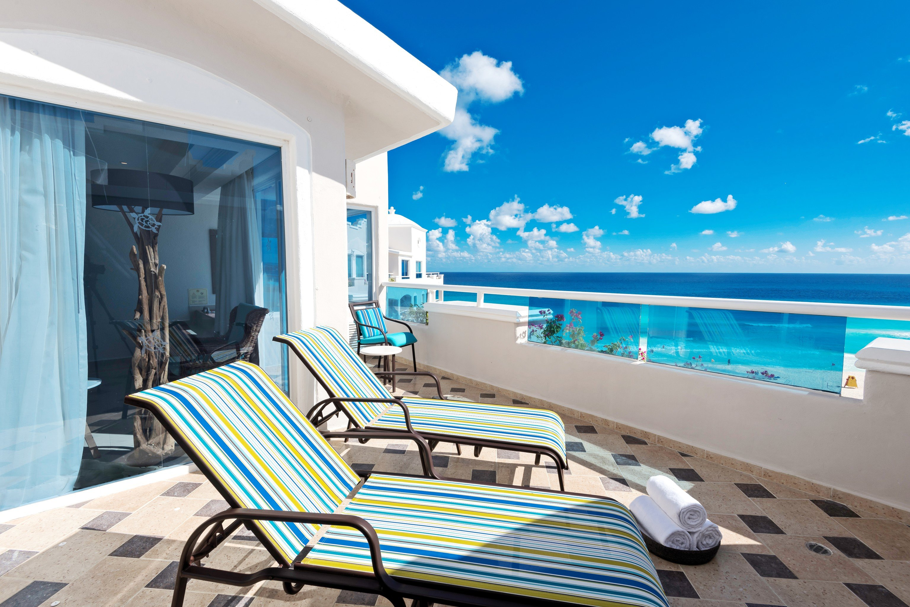 All-Inclusive Resorts caribbean Family Travel Hotels property swimming pool Resort estate vacation real estate home apartment Sea penthouse apartment sunlounger Villa sky leisure outdoor furniture interior design resort town condominium hotel Balcony