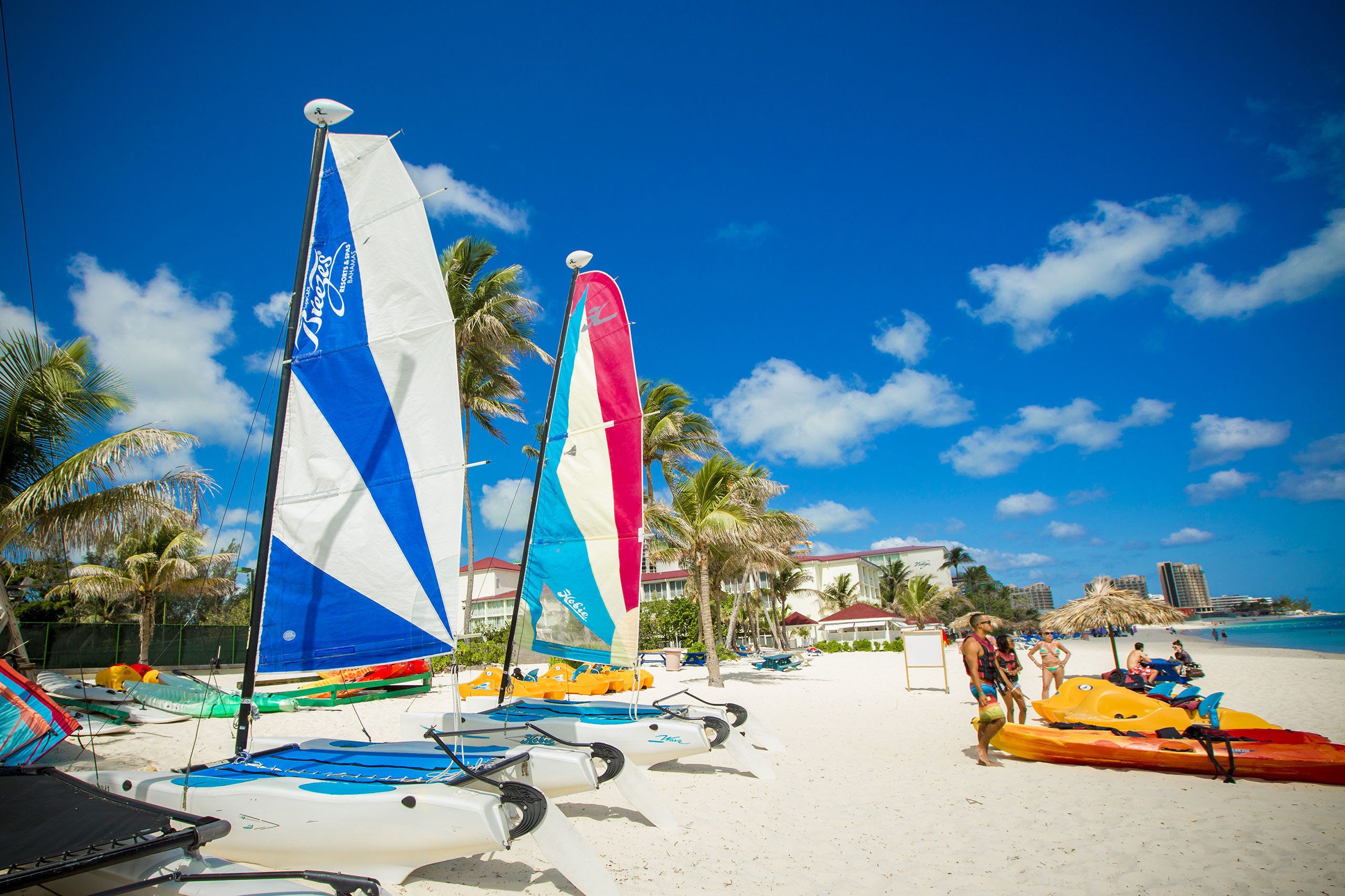 All-Inclusive Resorts Budget Hotels sky body of water water Beach Sea vacation water transportation tourism coastal and oceanic landforms cloud sail tree leisure Boat shore summer sailboat sailing Ocean Coast wave caribbean wind bay sand