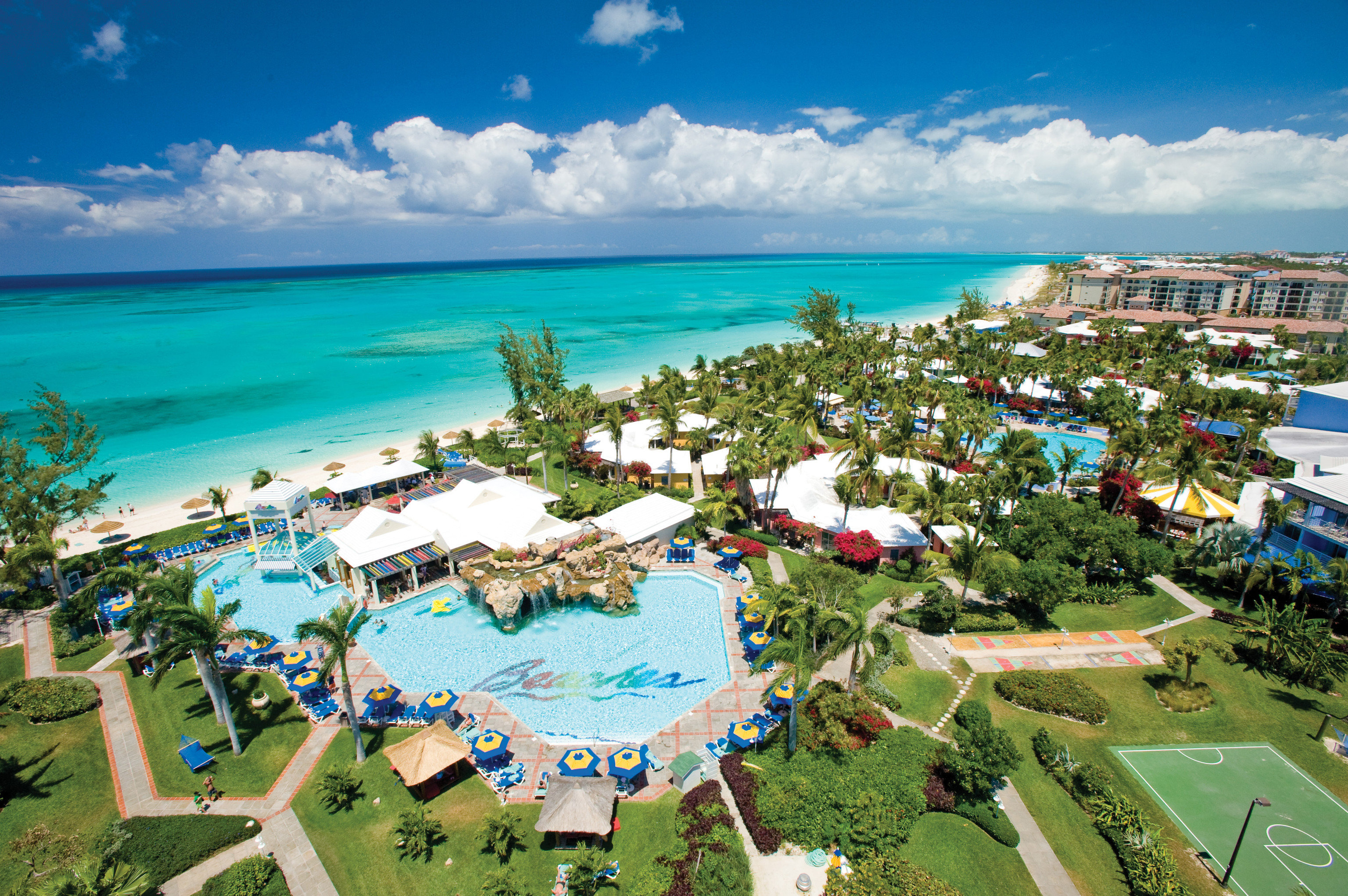 All-Inclusive Resorts Family Travel Hotels Resort resort town leisure tourism caribbean tropics vacation swimming pool aerial photography bay palm tree real estate sky arecales bird's eye view Coast estate Sea Lagoon