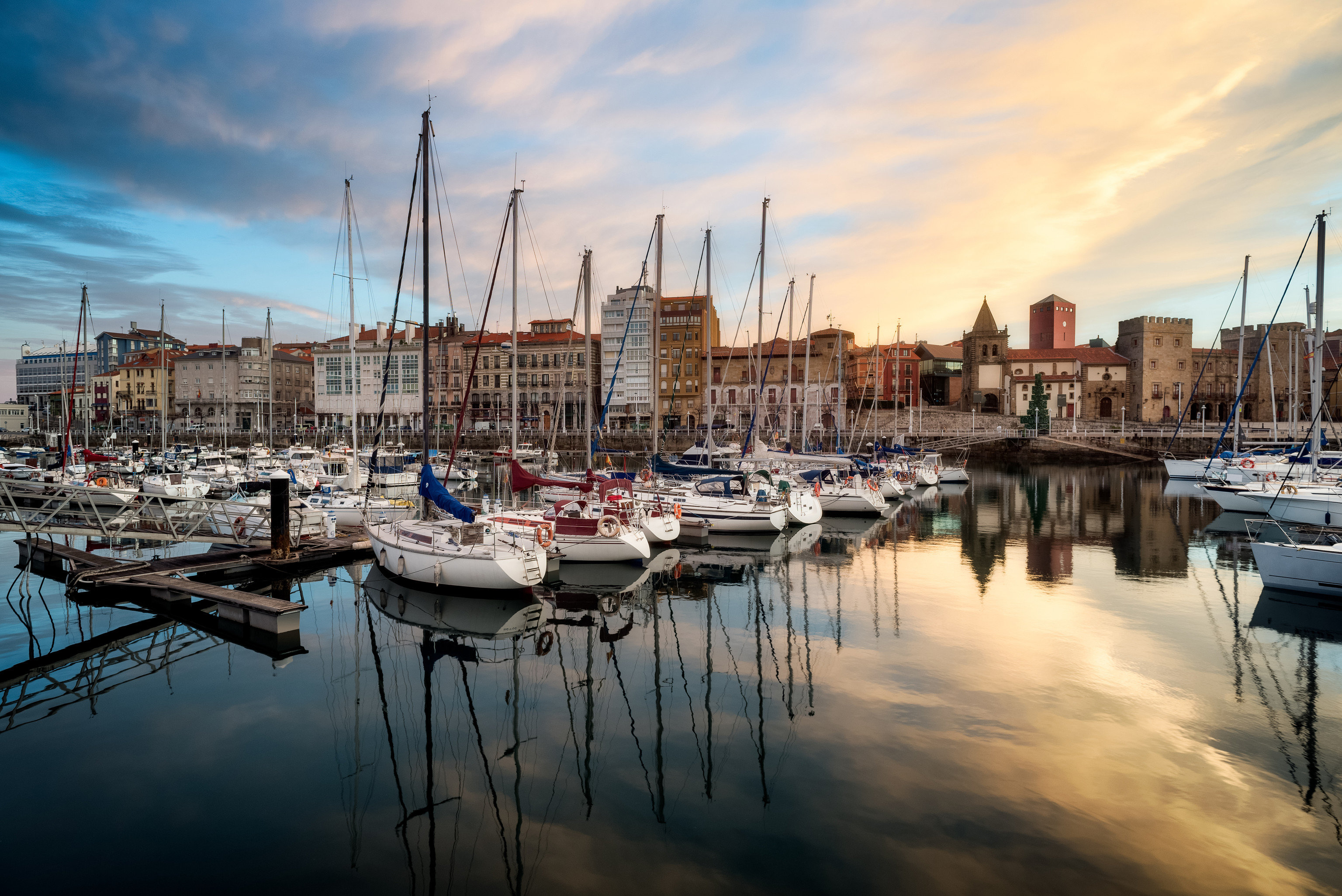 Austria England europe France Germany Italy Outdoors + Adventure Portugal Spain Trip Ideas marina reflection Harbor water sky body of water waterway dock cityscape urban area Boat City port evening morning horizon dusk watercraft calm channel skyline Sea cloud Downtown Sunset