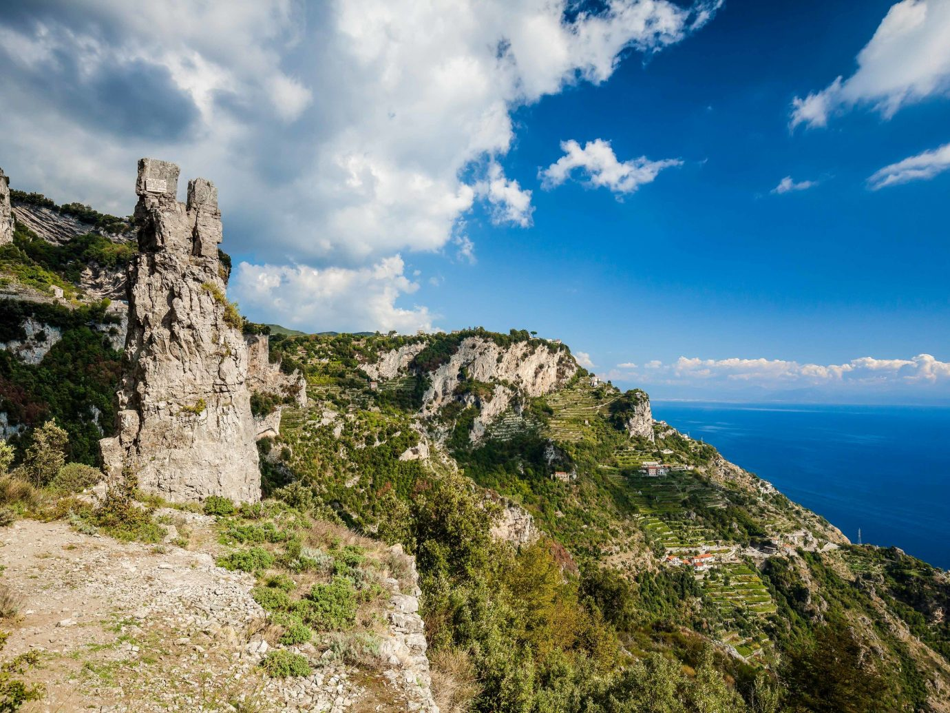europe Outdoors + Adventure Trip Ideas sky cloud promontory highland cliff mount scenery Coast mountain terrain rock escarpment klippe tourism cape Sea tree national trust for places of historic interest or natural beauty meteorological phenomenon landscape building hill