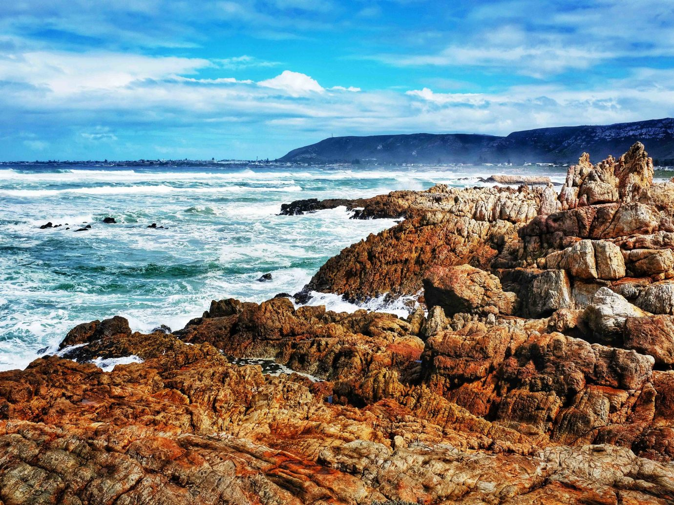 Hermanus Coast Sea shore sky rock promontory Ocean coastal and oceanic landforms headland cape cliff terrain cloud formation geology horizon wave water Beach bay cove landscape