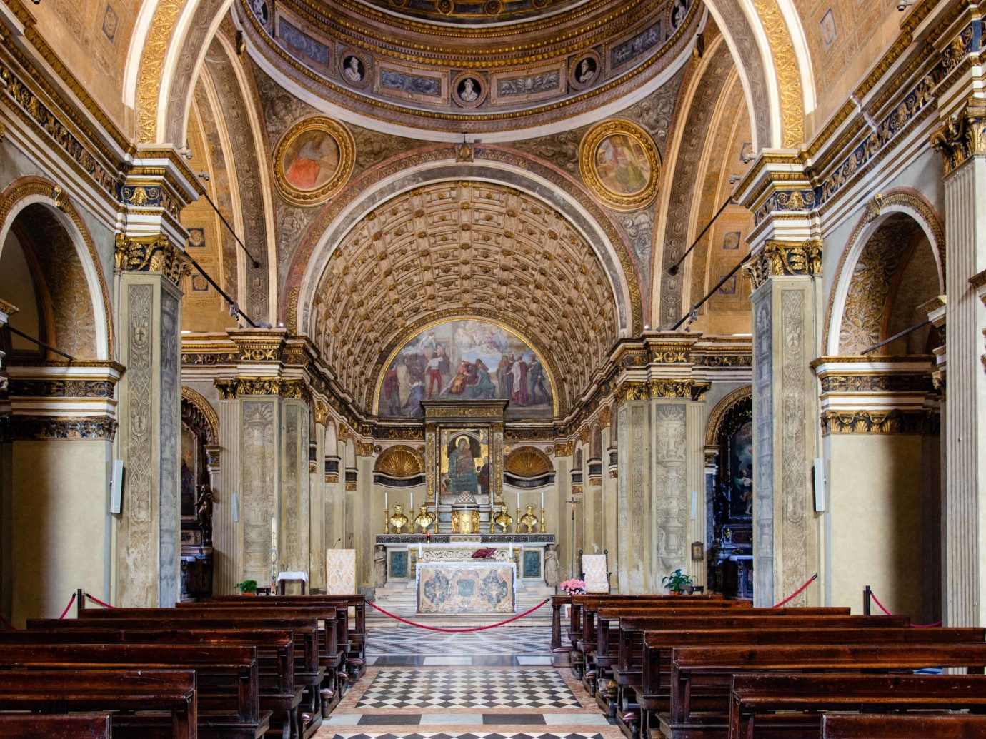Arts + Culture Italy Milan place of worship indoor building religious institute Church chapel cathedral basilica byzantine architecture historic site column medieval architecture arch symmetry classical architecture abbey aisle worship wooden altar religion interior design synagogue window stone
