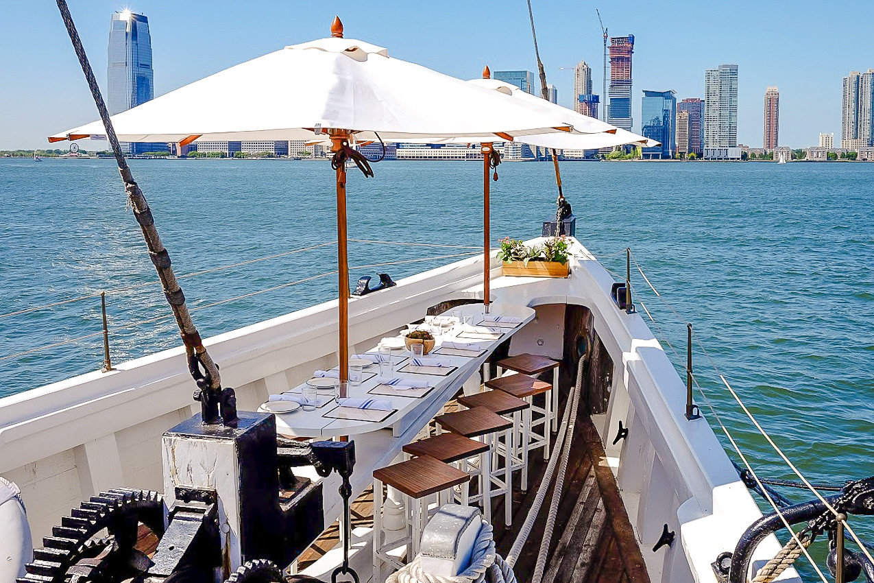 Food + Drink NYC water transportation Sea Boat water watercraft boating ship vehicle Deck ferry yacht Ocean vacation passenger ship dock channel sky