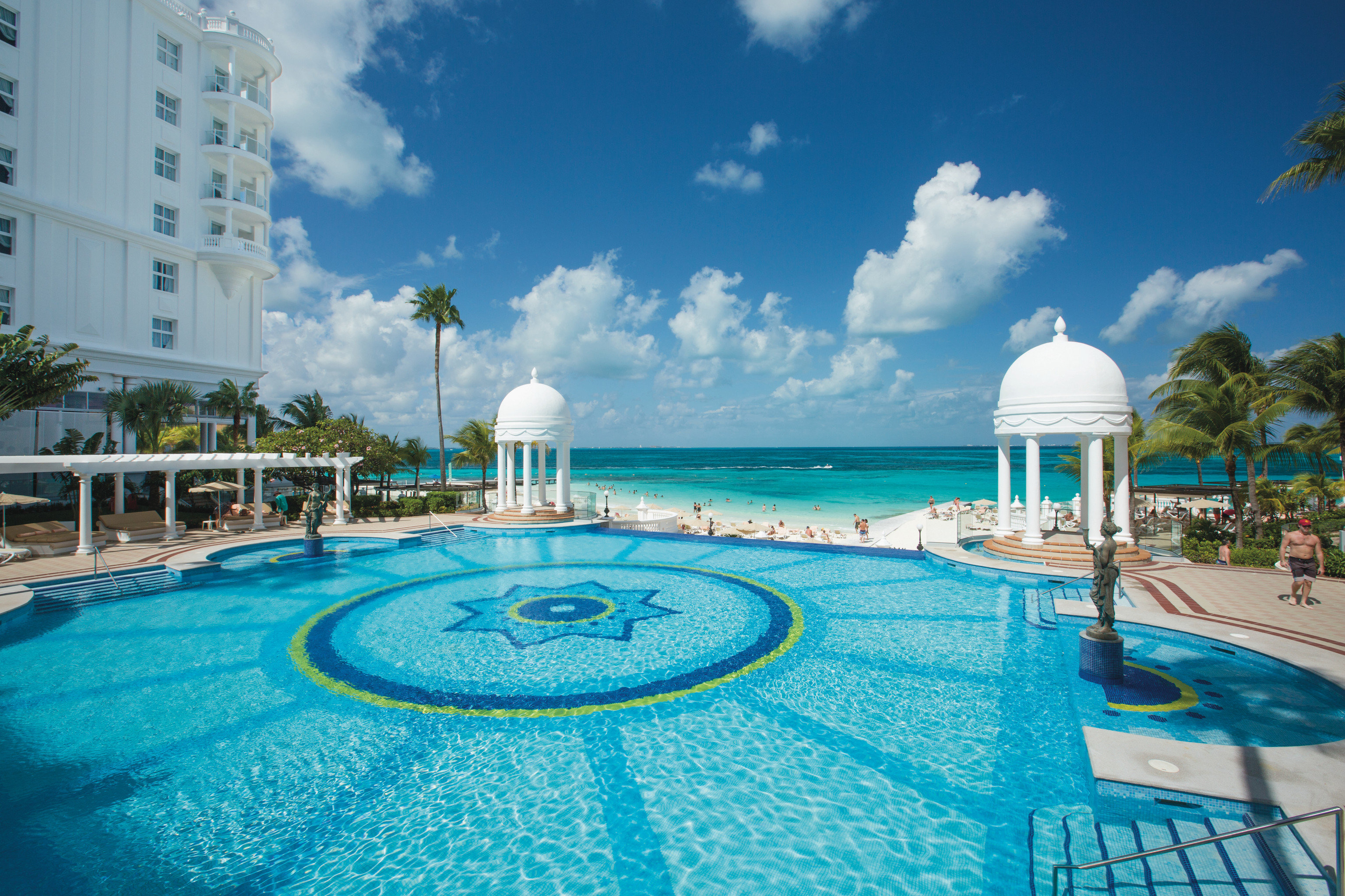 Adult-only All-Inclusive Resorts Cancun Hotels Mexico Resort swimming pool leisure resort town property caribbean sky vacation Sea palm tree water tropics daytime arecales tourism real estate estate Ocean hotel leisure centre condominium coastal and oceanic landforms recreation Lagoon Villa bay