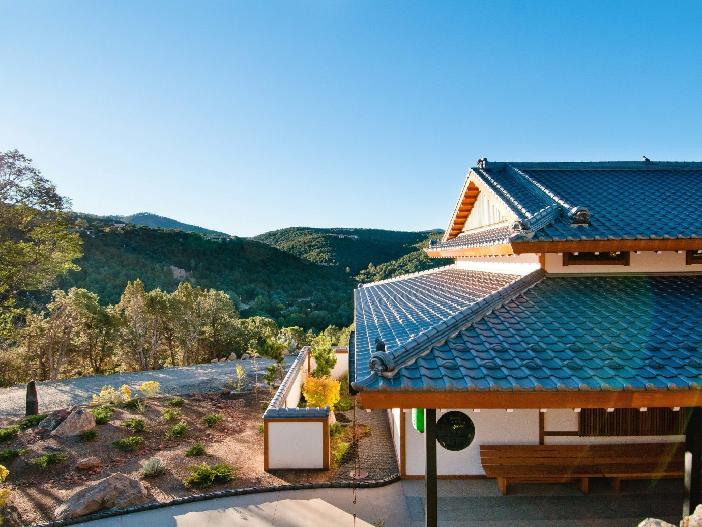 roof property sky plant real estate house home mountain leisure tree outdoor structure landscape estate water cottage mountain range energy Villa tourism vacation Resort elevation facade