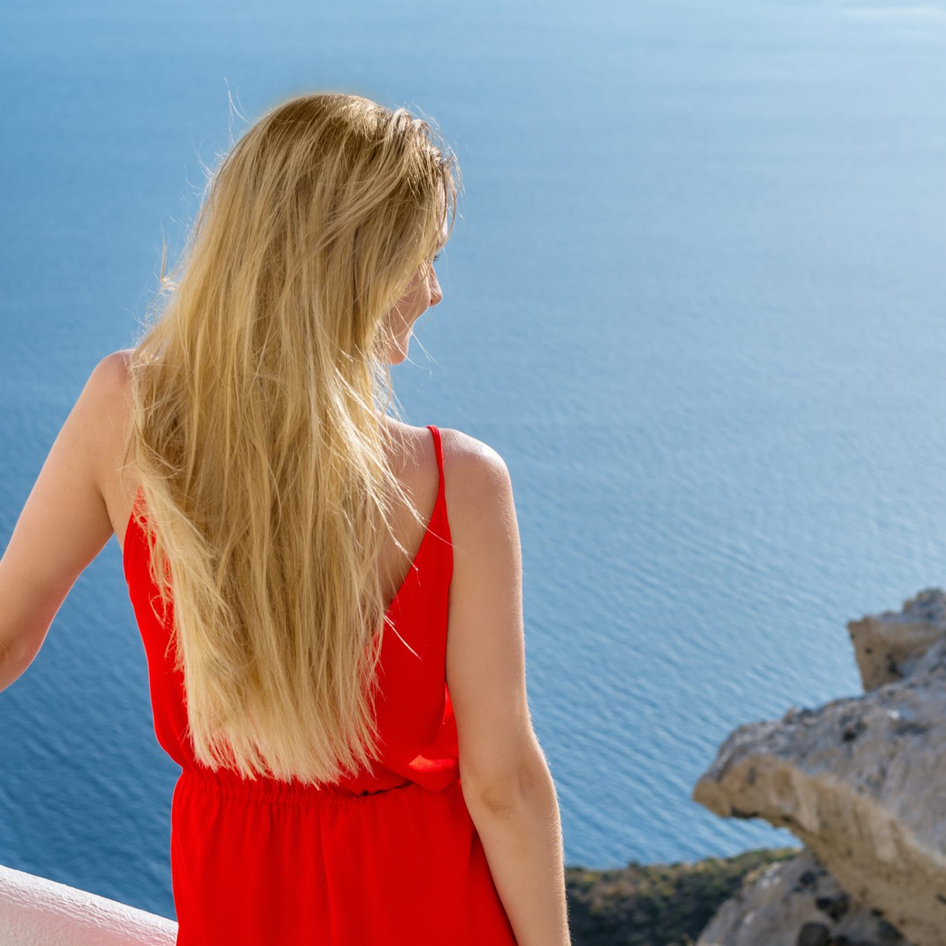 Best Jumpsuits for summer, woman in jumpsuit and view of the ocean
