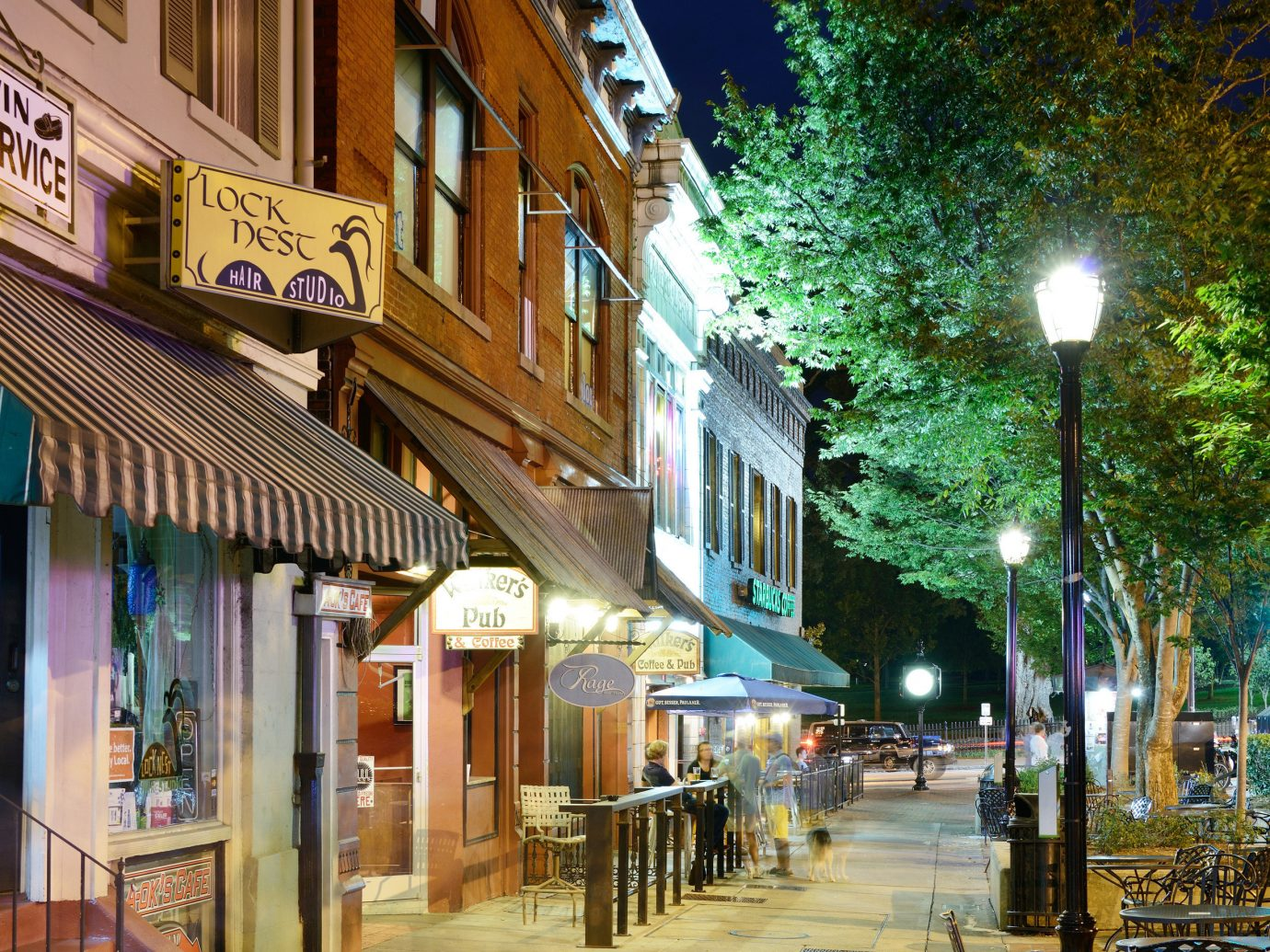 Trip Ideas building outdoor Town neighbourhood way street City scene mixed use Architecture Downtown night alley residential area road home evening house facade real estate sidewalk sky tree metropolitan area lane window