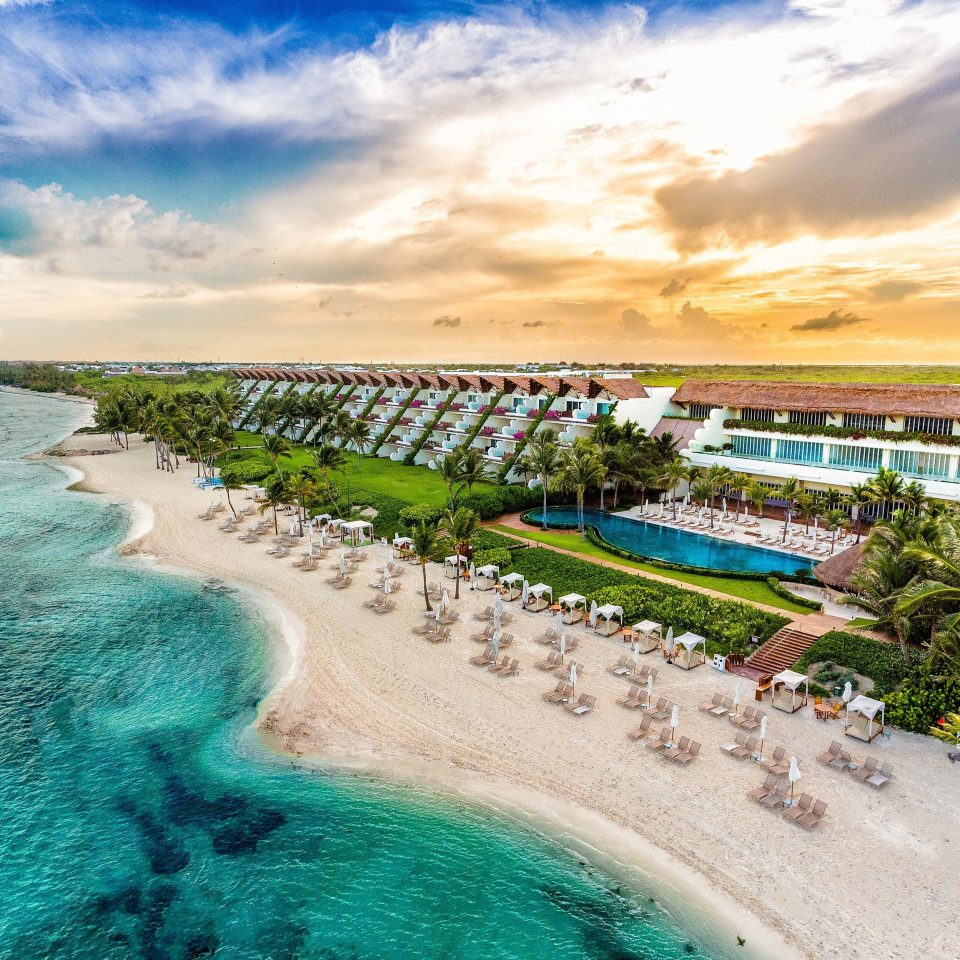 All-inclusive All-Inclusive Resorts Mexico Riviera Maya, Mexico Resort Sea sky shore caribbean tropics Beach swimming pool Ocean palm tree Coast arecales cloud horizon leisure water coastal and oceanic landforms Lagoon landscape resort town