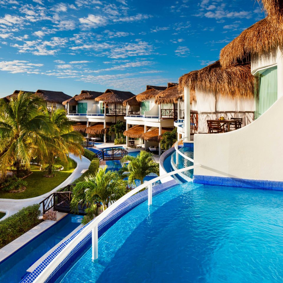 All-inclusive All-Inclusive Resorts Mexico Riviera Maya, Mexico Resort property swimming pool leisure home resort town Villa caribbean hacienda palm tree mansion arecales condominium house