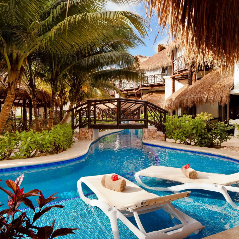 All-Inclusive Resorts Resort swimming pool leisure property resort town palm tree arecales Villa hacienda tropics tree water caribbean amenity