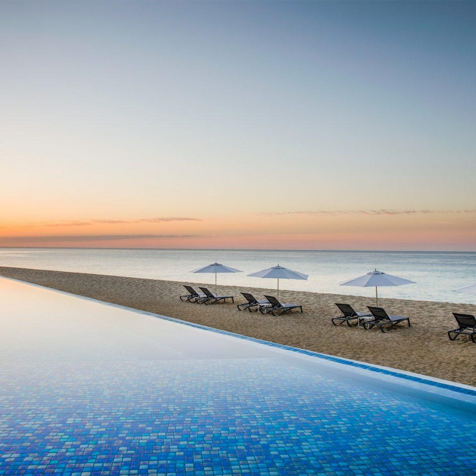 Sea horizon sky water Ocean calm shore morning coastal and oceanic landforms sunrise Sunset Beach dawn Coast sunlight evening sand dusk