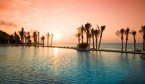 water sky Boat Sea Sunset palm tree horizon swimming pool arecales evening Resort leisure Nature sunrise tropics tree caribbean calm dusk Ocean shore Lake computer wallpaper day