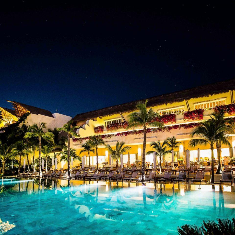 Resort leisure night resort town swimming pool sky water mixed use City evening condominium palm tree computer wallpaper marina