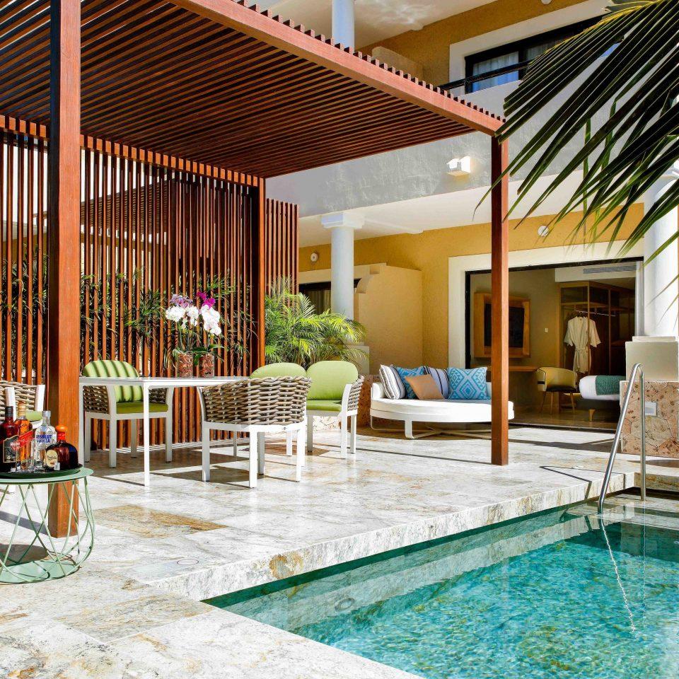 property swimming pool Resort home house Villa outdoor structure backyard Patio Courtyard leisure condominium amenity