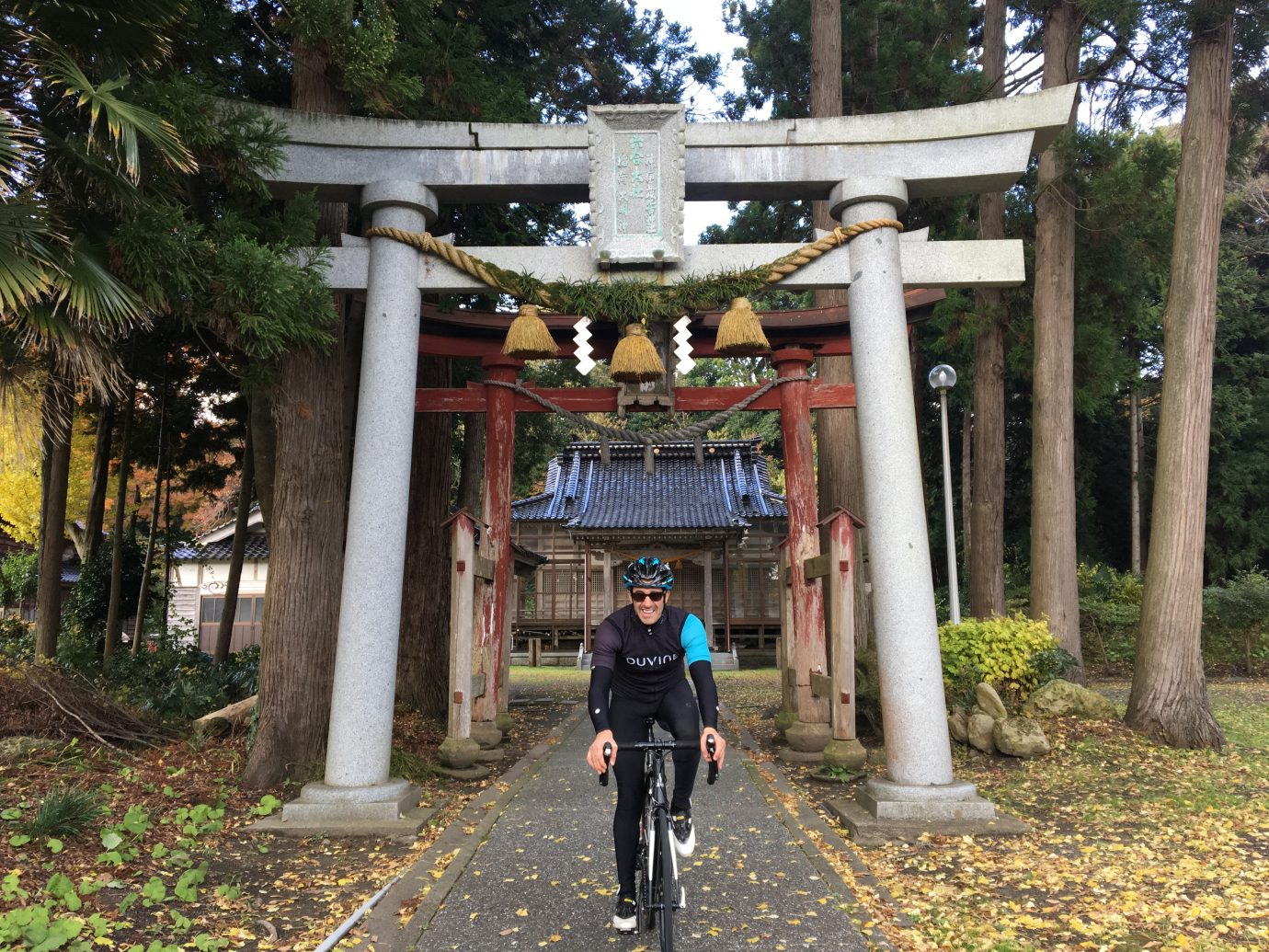 biking by a temple in Japan