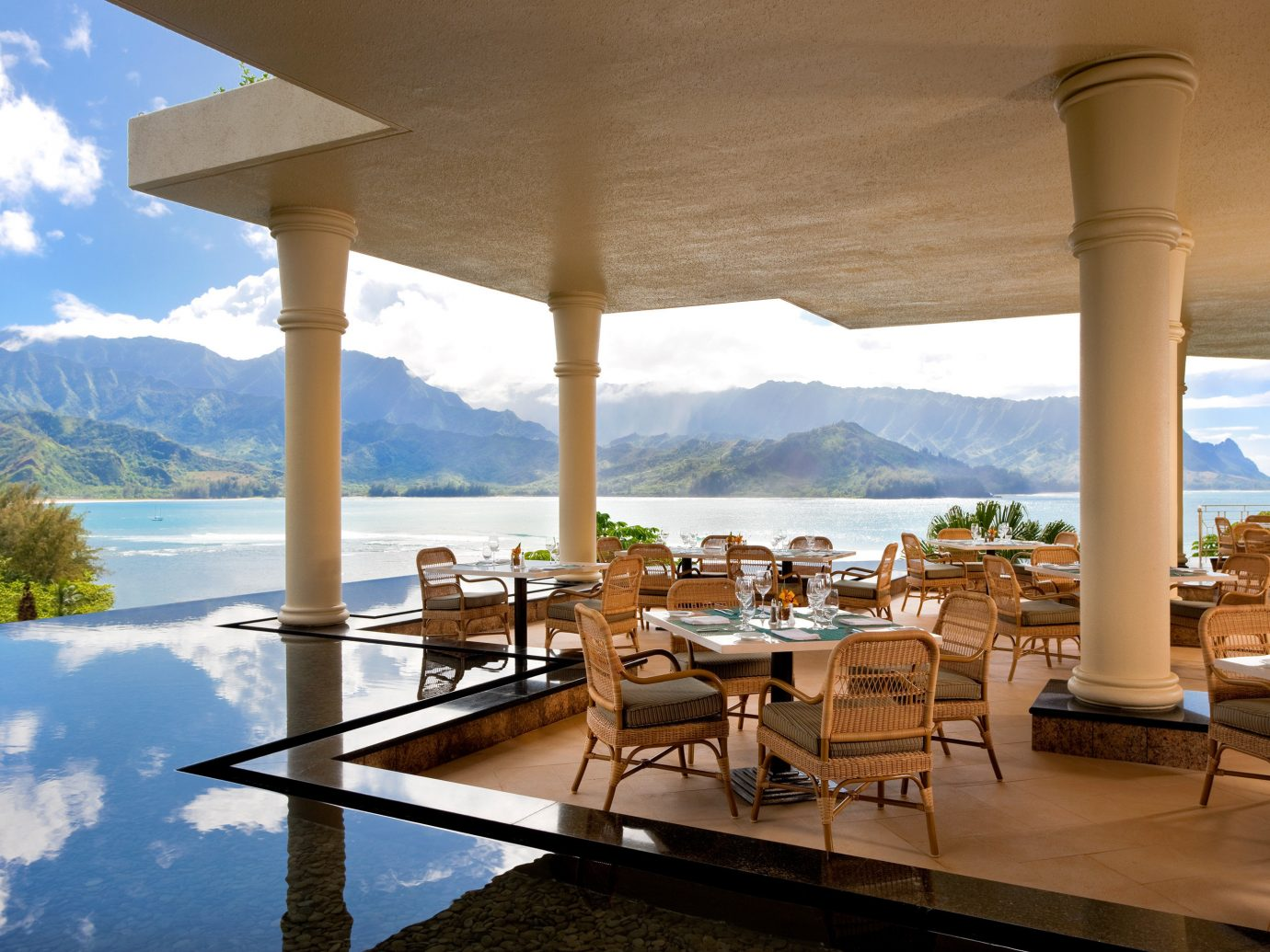 Outdoor patio by ocean at St. Regis Princeville Resort