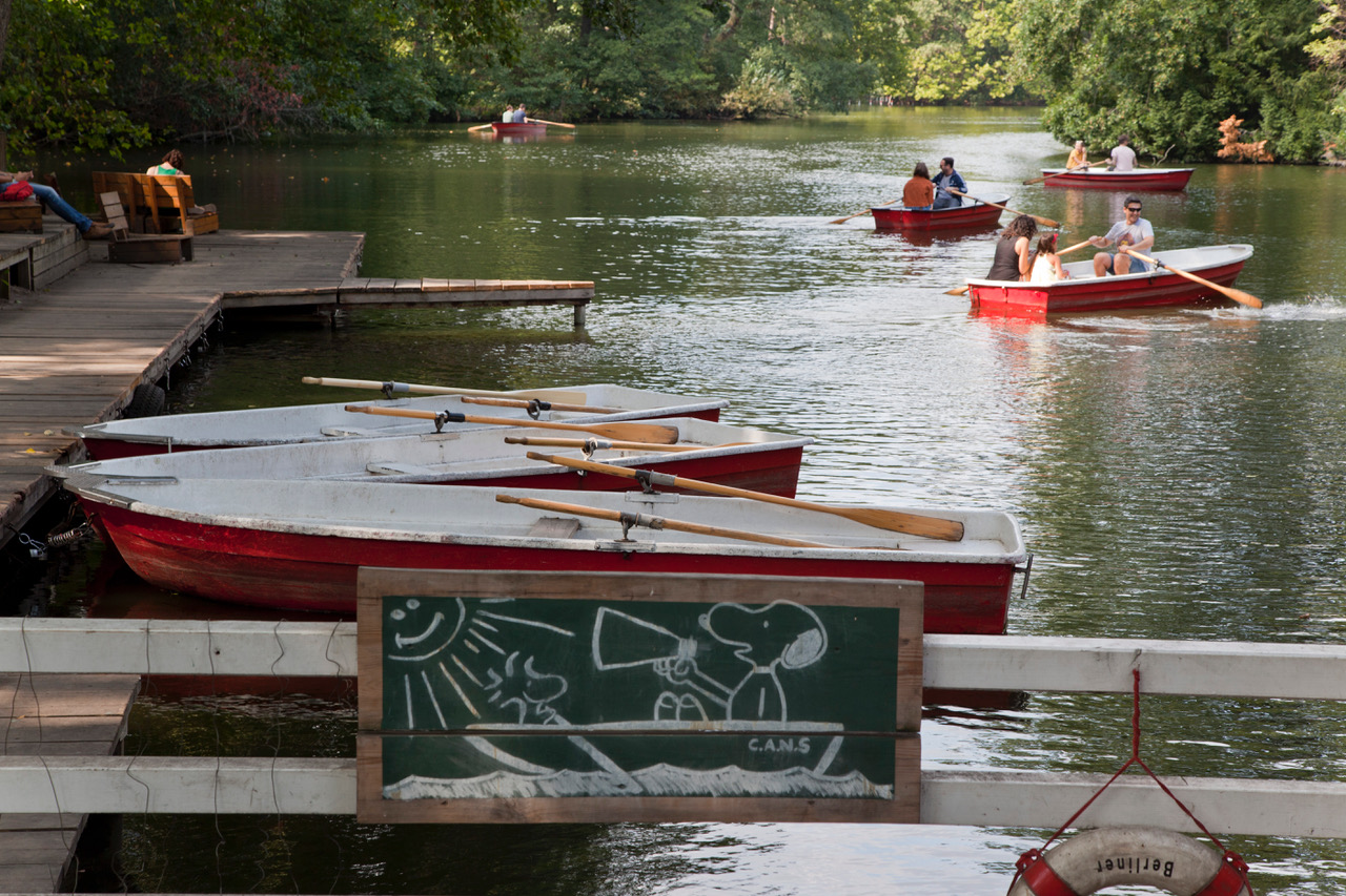 row boats in a lake beside Café am Neuen See