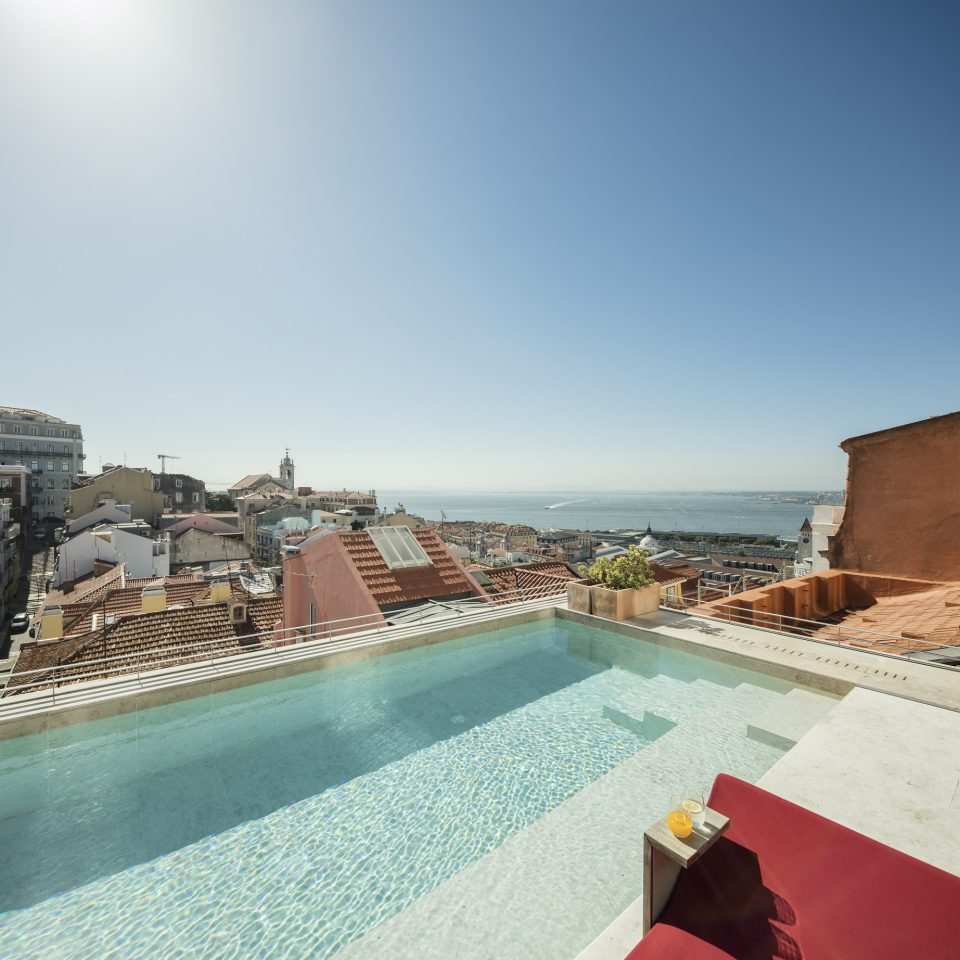 Rooftop swimming pool looking over Lisbon at Verride Palácio Santa Catarina